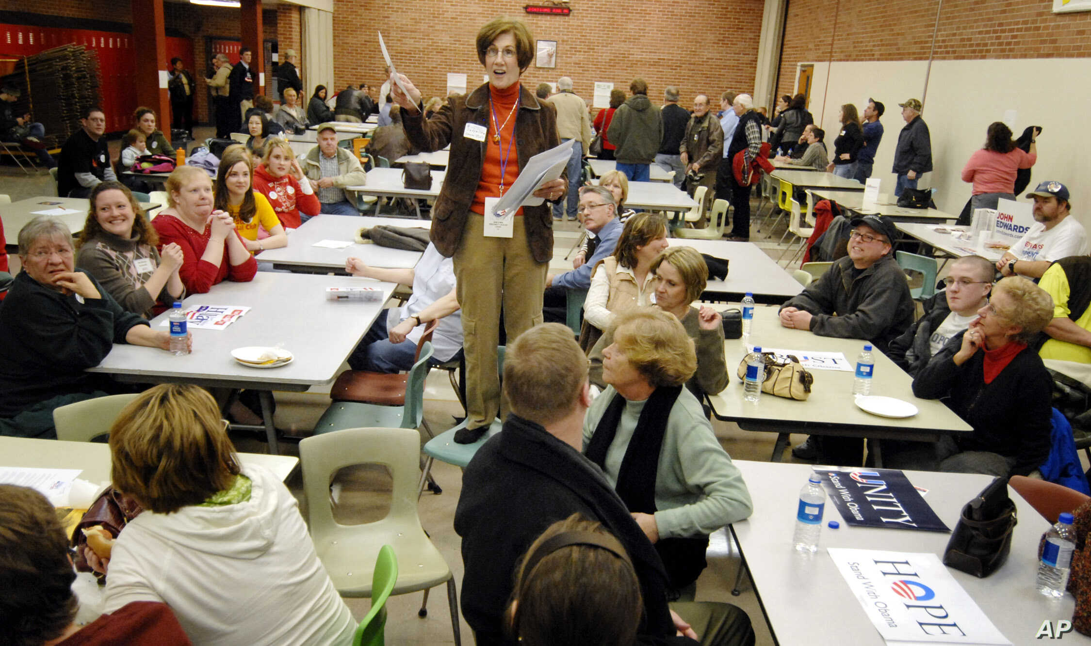 FILE - Precinct Chairwoman Judy Wittkop explains the rules during a caucus in Le Mars, Iowa, Jan. 3, 2008.