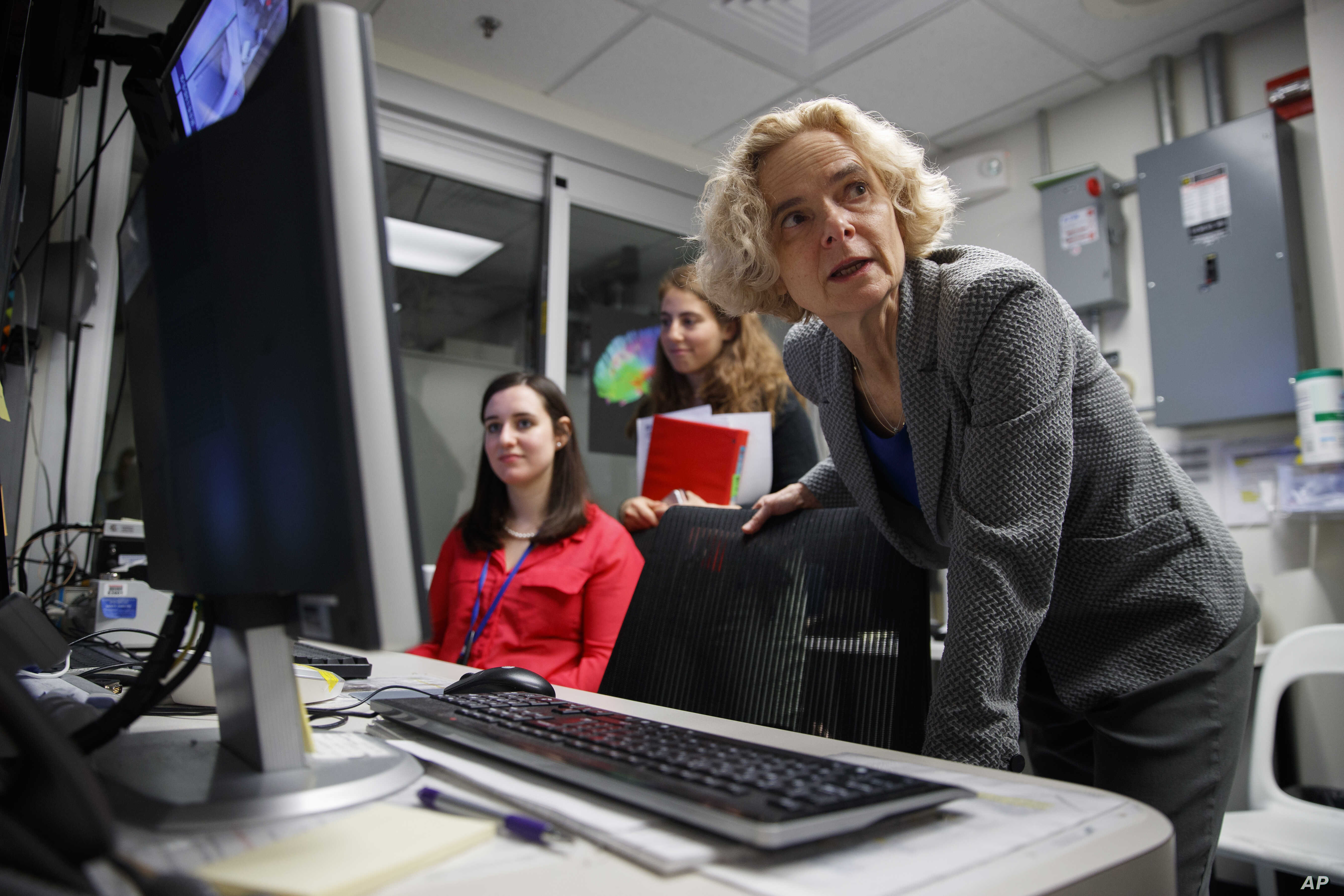 FILE - Dr. Nora Volkow, director of the National Institute on Drug Abuse, works in the MRI lab at the National Institutes of Health's research hospital in Bethesda, Maryland, May 16, 2019.