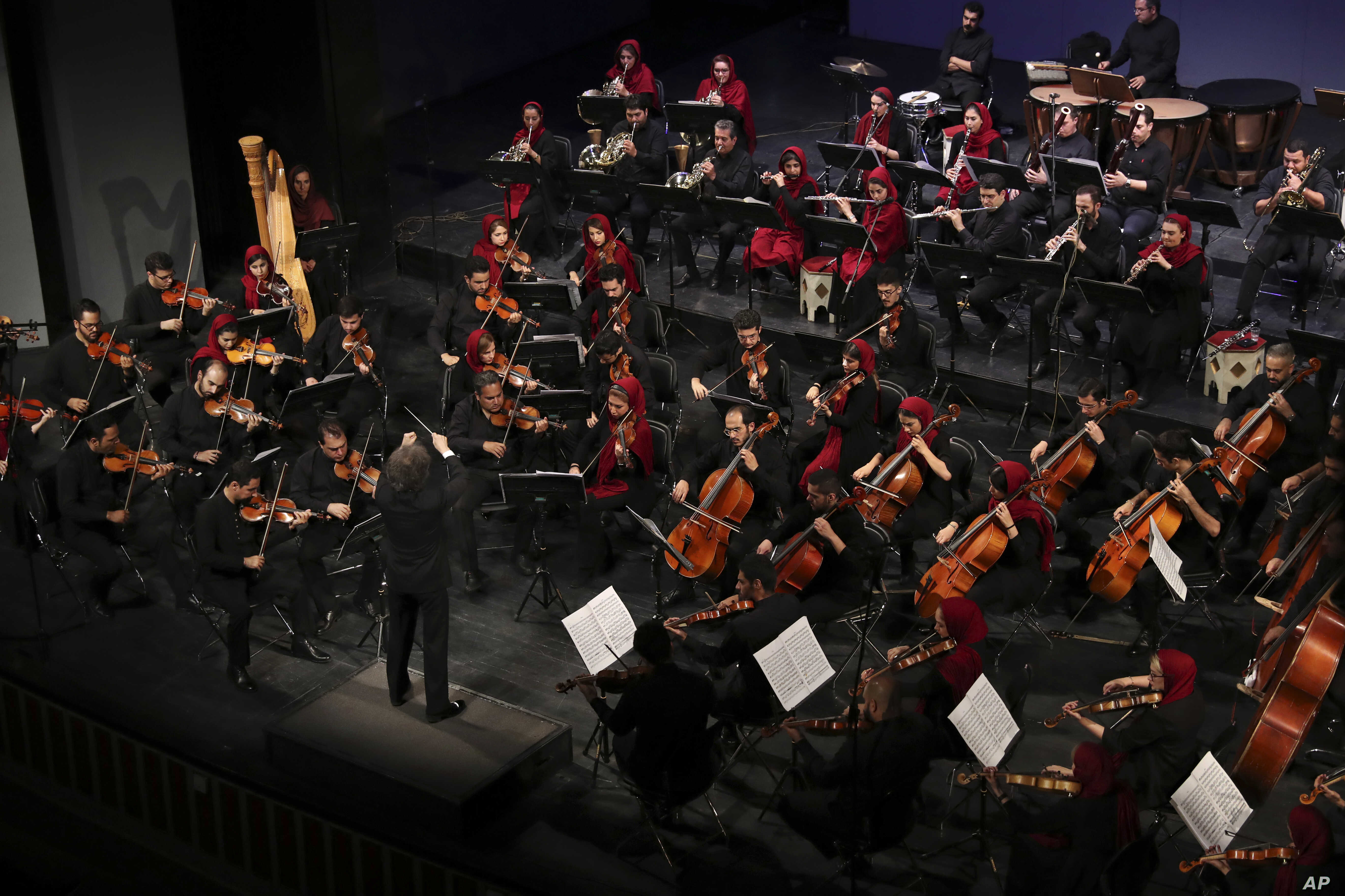 The Tehran Symphony Orchestra performs pieces by 19th-century Russian composers in Unity Hall, in Tehran, Iran, July 3, 2019.