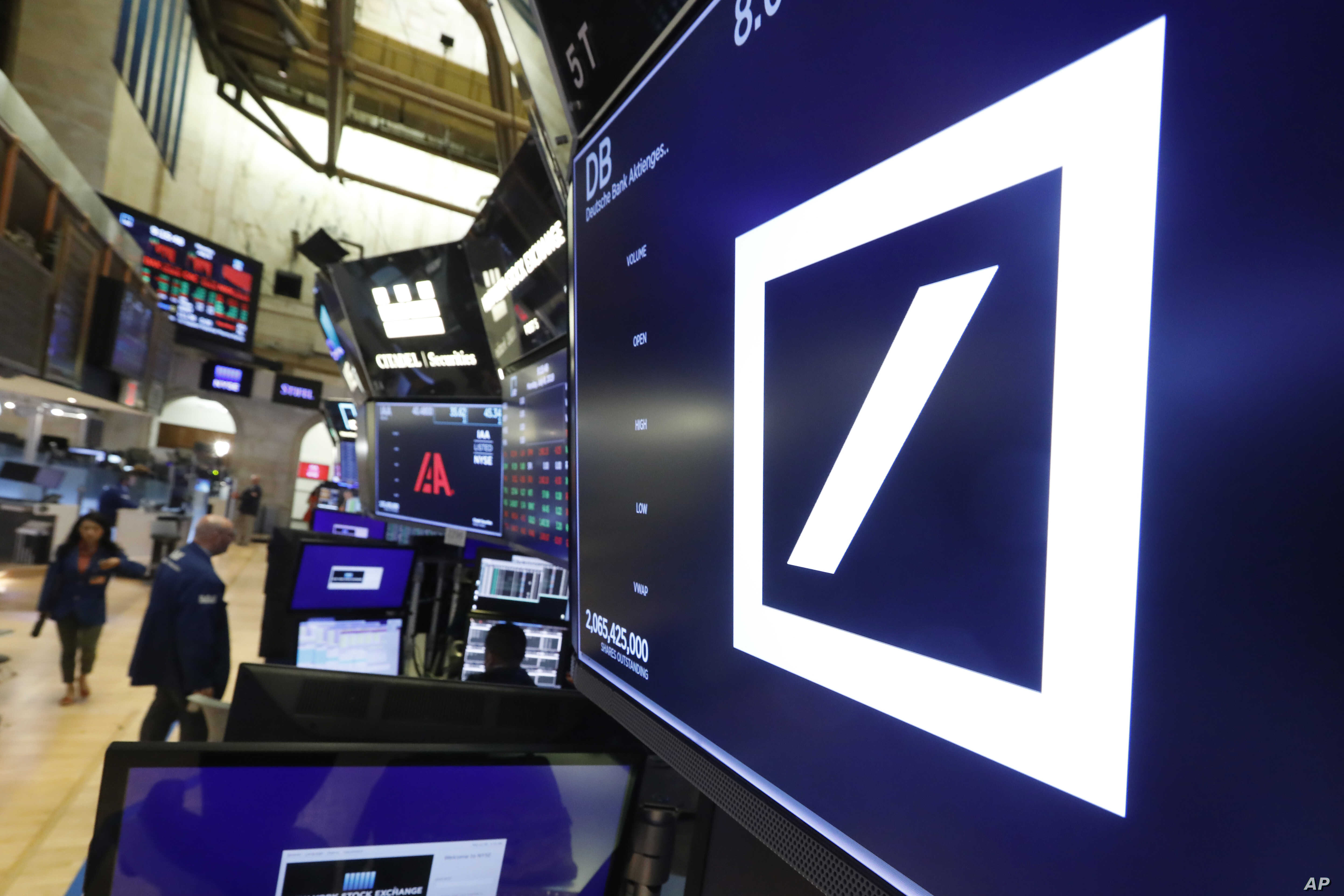 The logo for Deutsche Bank appears above a trading post on the floor of the New York Stock Exchange, July 8, 2019.