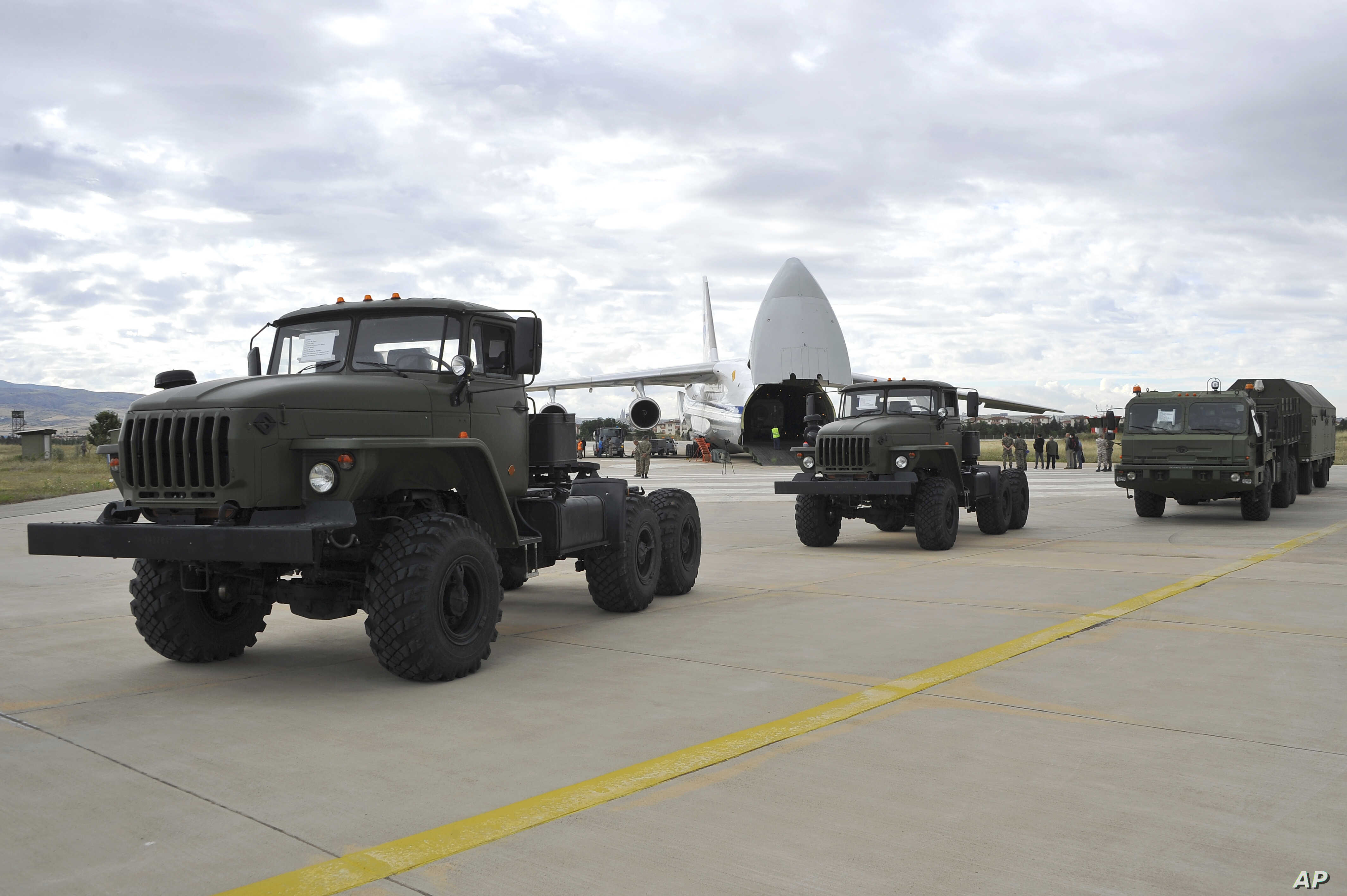 Military vehicles and equipment, parts of the S-400 air defense systems, are seen on the tarmac after they were unloaded from a Russian transport aircraft, at Murted military airport in Ankara, Turkey, July 12, 2019.
