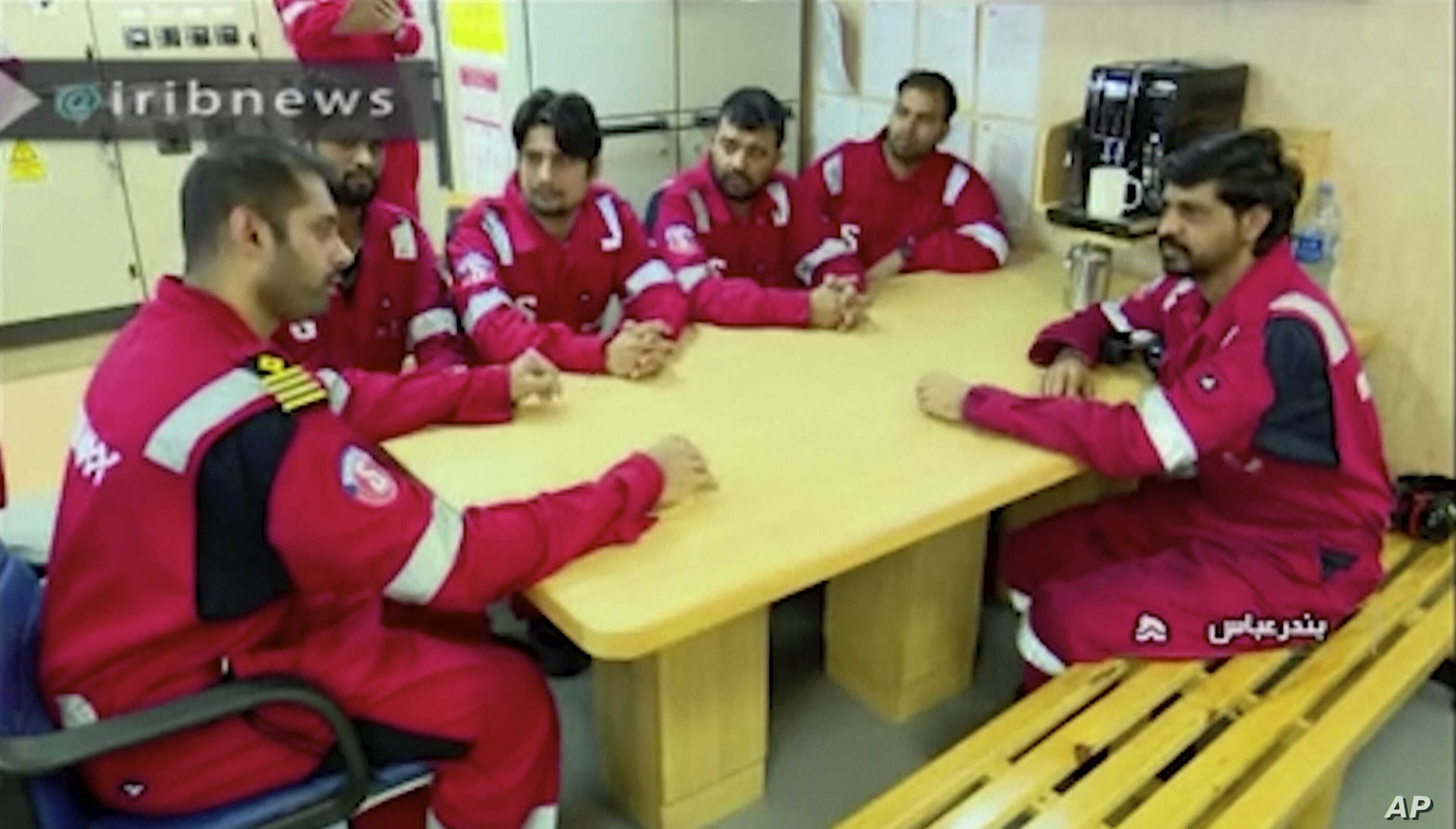 This photo released by state-run IRIB News Agency, which aired July 22, 2019, shows various crew members of the British-flagged tanker Stena Impero, which was seized by Tehran in the Strait of Hormuz on Friday, during a meeting.