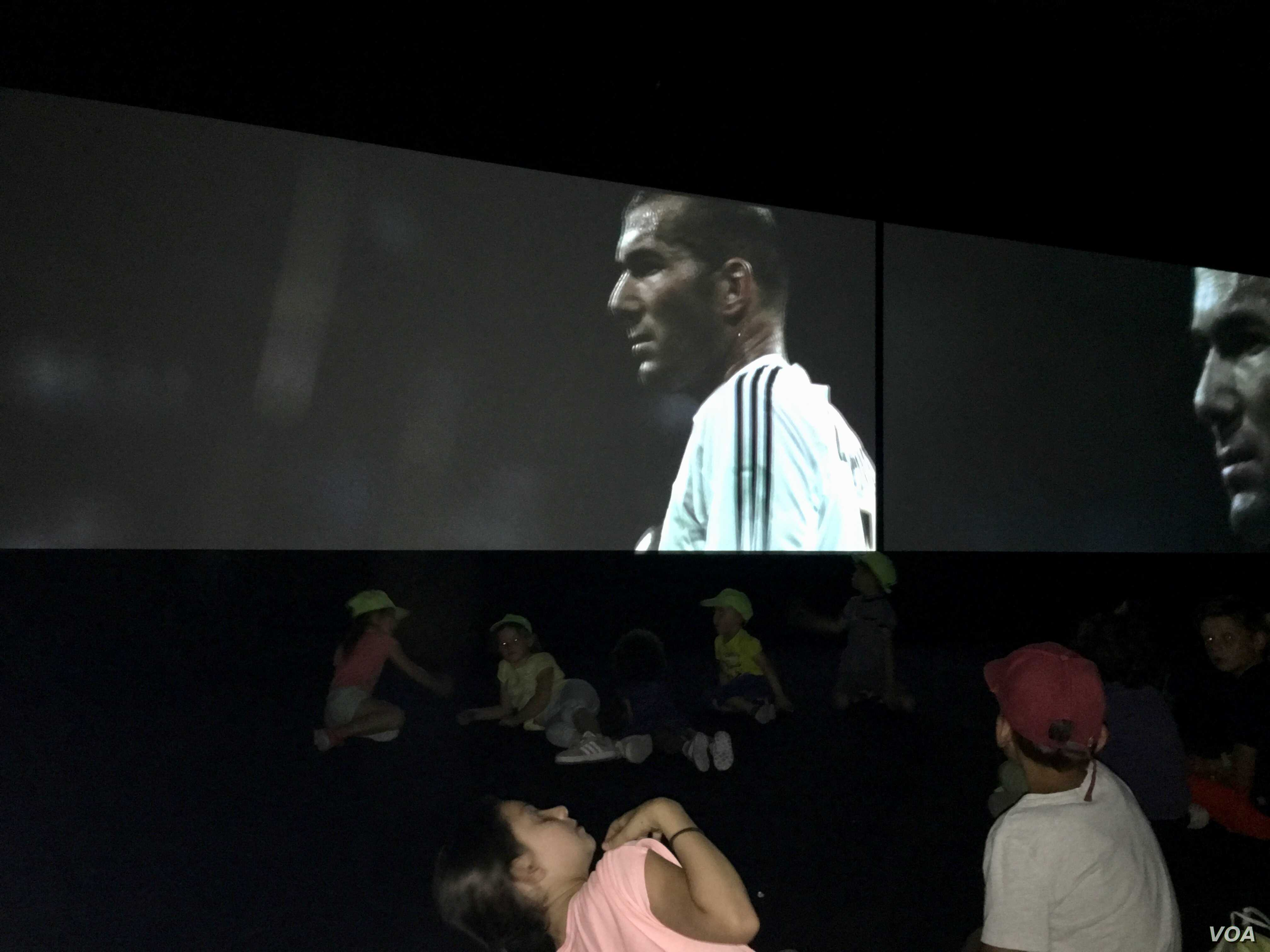 Children watch star player Zinedine Zidane of Algerian descent in replay of 1998 French World Cup victory. (Lisa Bryant/VOA)