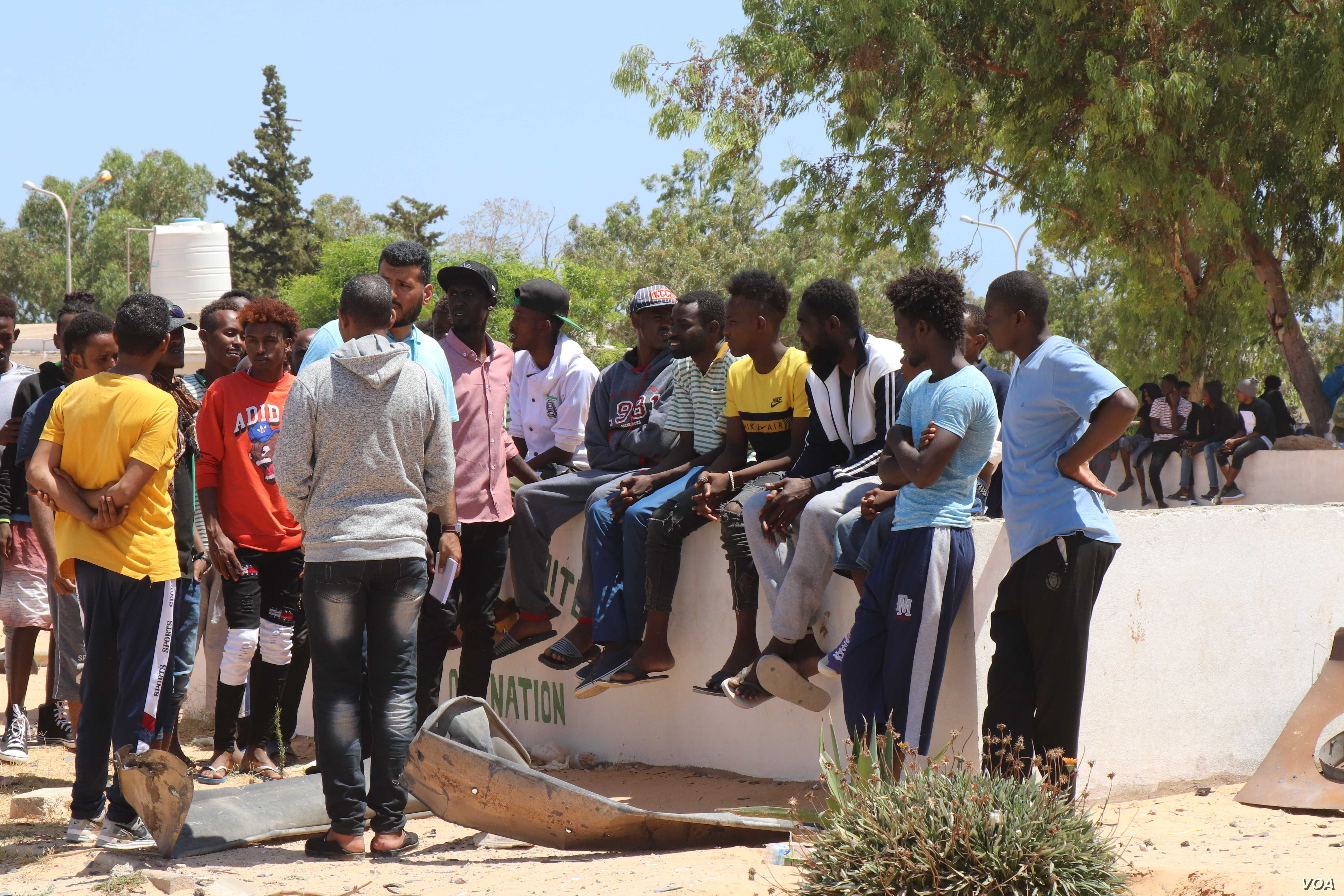 Survivors evacuated the crumbled detention center and spent the night outside while officials searched for the injured and the dead on July 3, 2019 in Tripoli, Libya (H.Murdock/VOA)