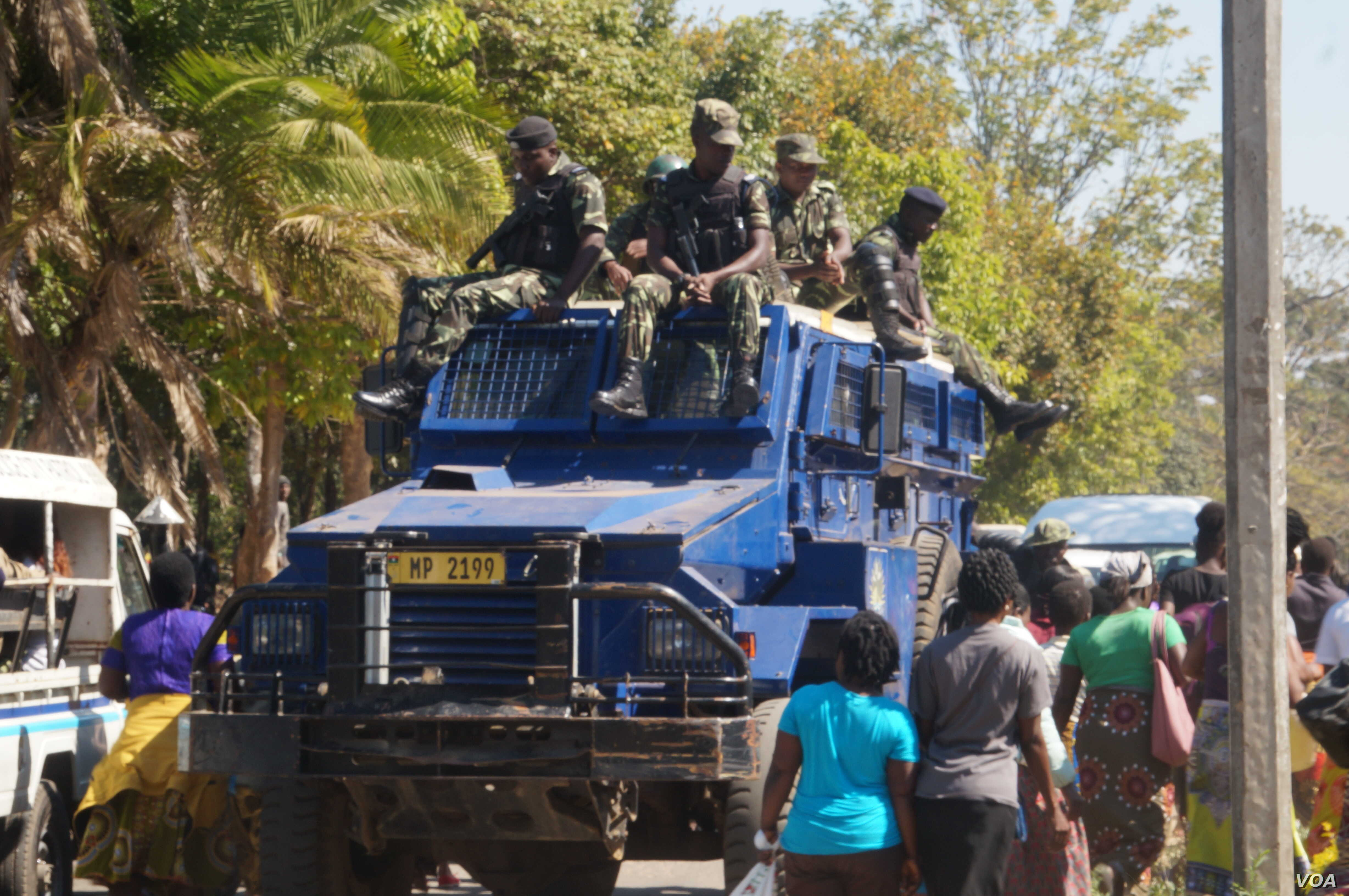 Malawi police provide security as women march in Blantyre, July 10, 2019. (Lameck Masina)
