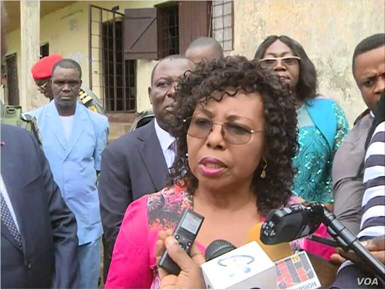 Cameroon's minister of secondary education, Nalova Lyonga, speaks to the media after encouraging teachers to go to school, in Buea, Cameroon, July 17, 2019. (Moki Kindzeka/VOA)