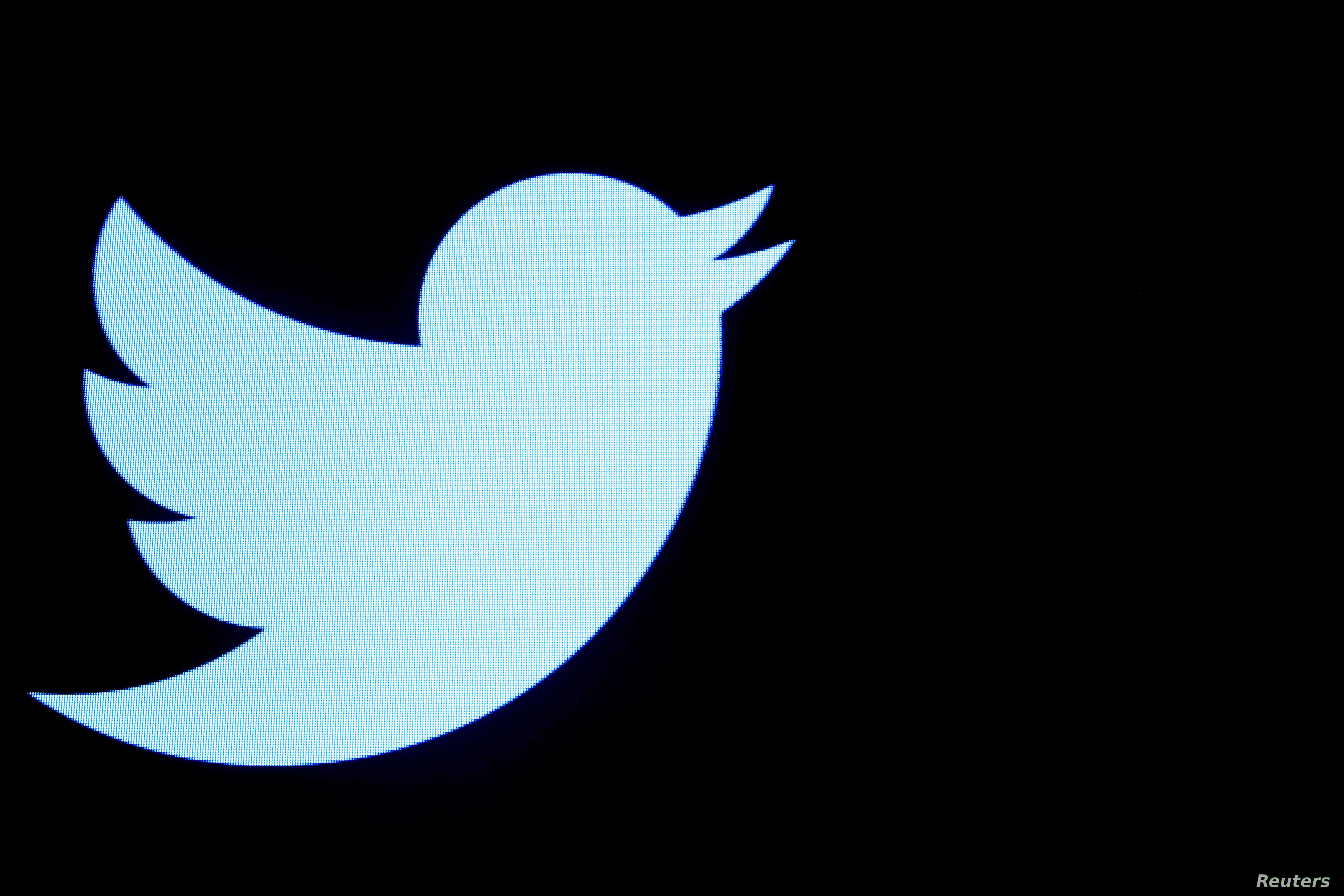 FILE - The Twitter logo is displayed on a screen on the floor of the New York Stock Exchange (NYSE) in New York City.