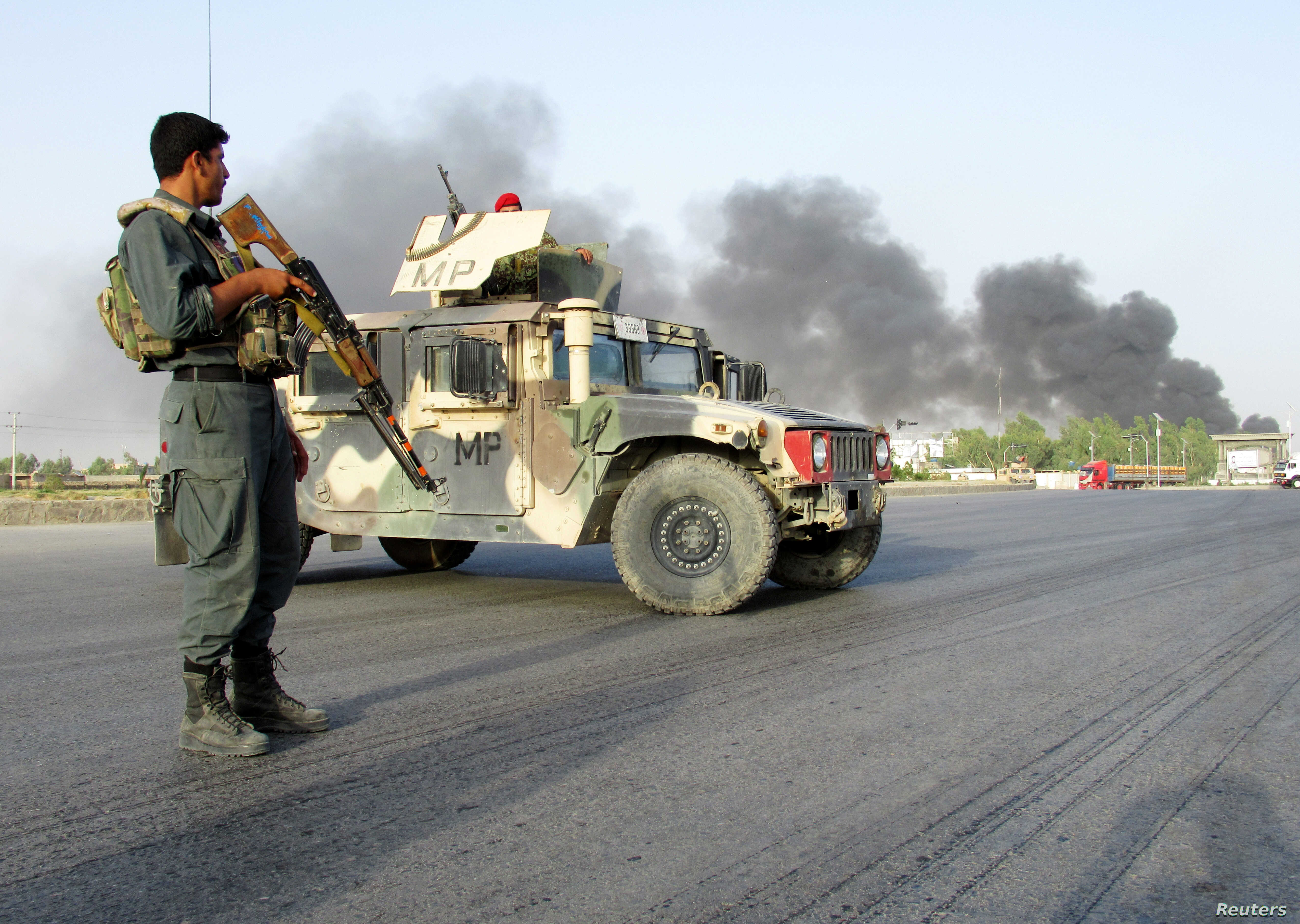 Vehicle bomb explodes at gate of police headquarters in Afghanistan's Kandahar