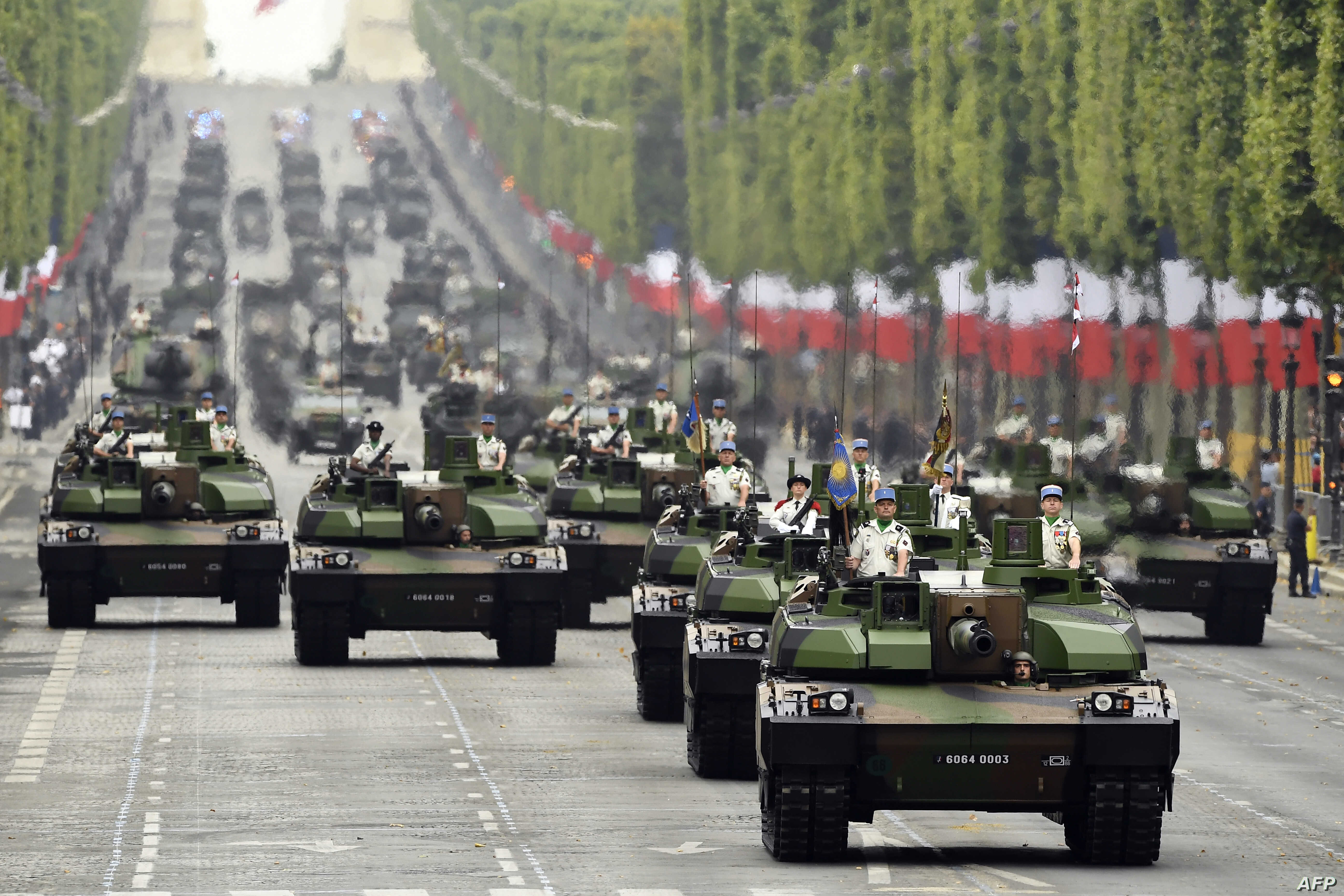 French soldiers parade in military vehicles during the Bastille Day military parade down the Champs-Elysees avenue in Paris, July 14, 2019.