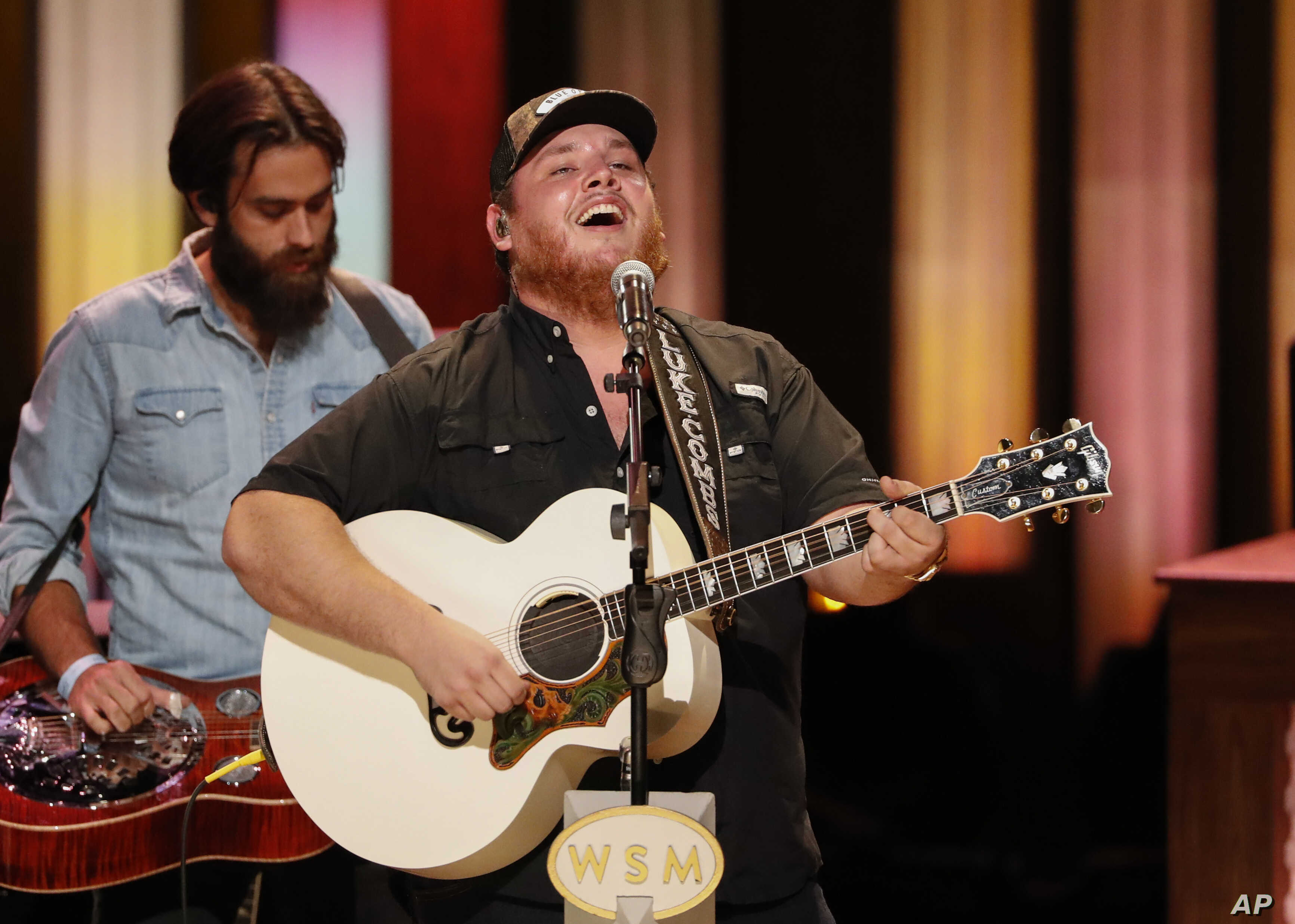 "Luke Combs performs at ""Luke Combs Joins the Grand Ole Opry Family,"" at the Grand Ole Opry, Tuesday, July 16, 2019, in Nashville, Tenn."