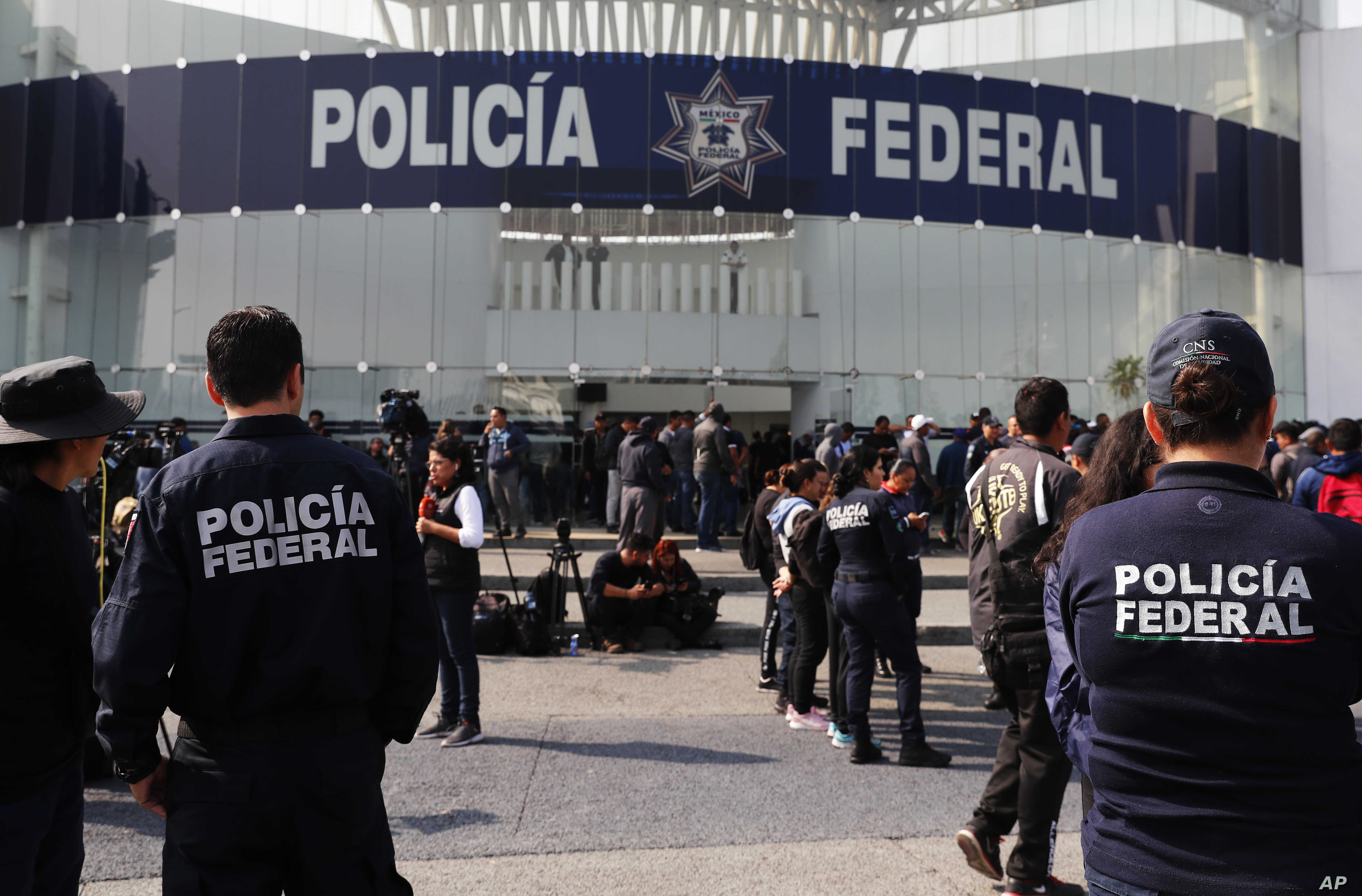 Striking police continue to hold a federal police command center in the Iztapalapa borough, in Mexico City, July 4, 2019, to protest against plans to force them into the newly formed National Guard.