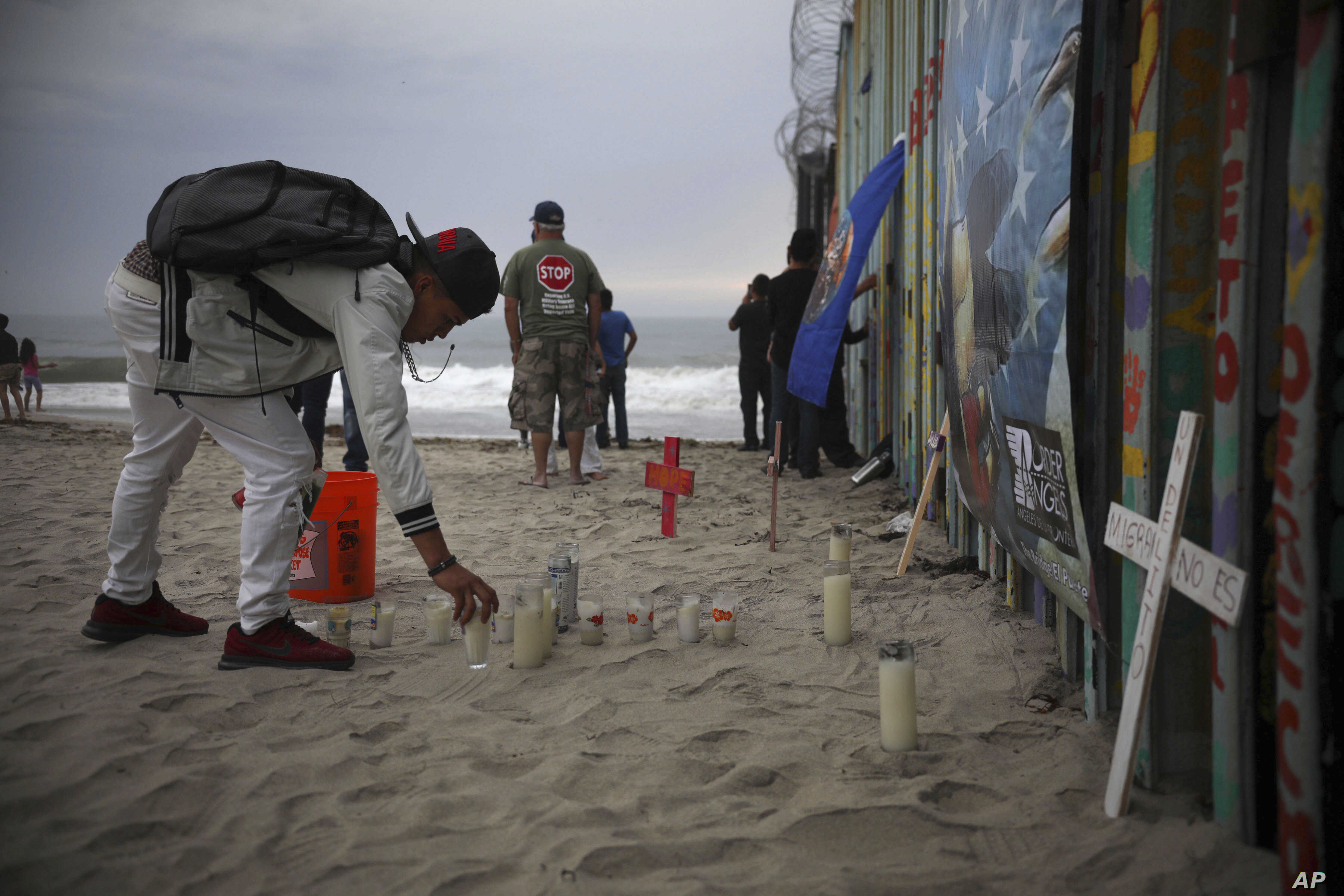 Candles are placed next to the border fence that separates Mexico from the United States, in memory of migrants who have died during their journey toward the U.S., in Tijuana, Mexico, June 29, 2019.