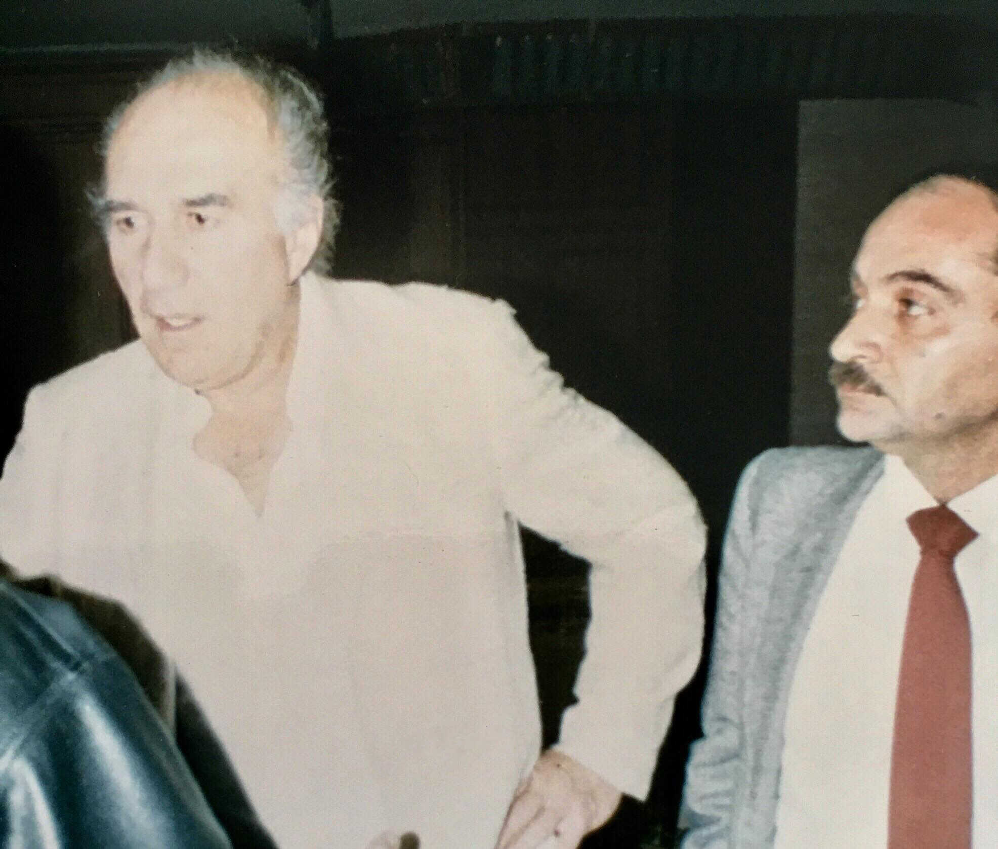 French movie star Michel Piccoli (L) stands next to Egyptian movie critic Youssef Cherif   Rizkallah at a press conference in Cairo, Egypt, Nov. 1987. (Photo: Diaa Bekheet)
