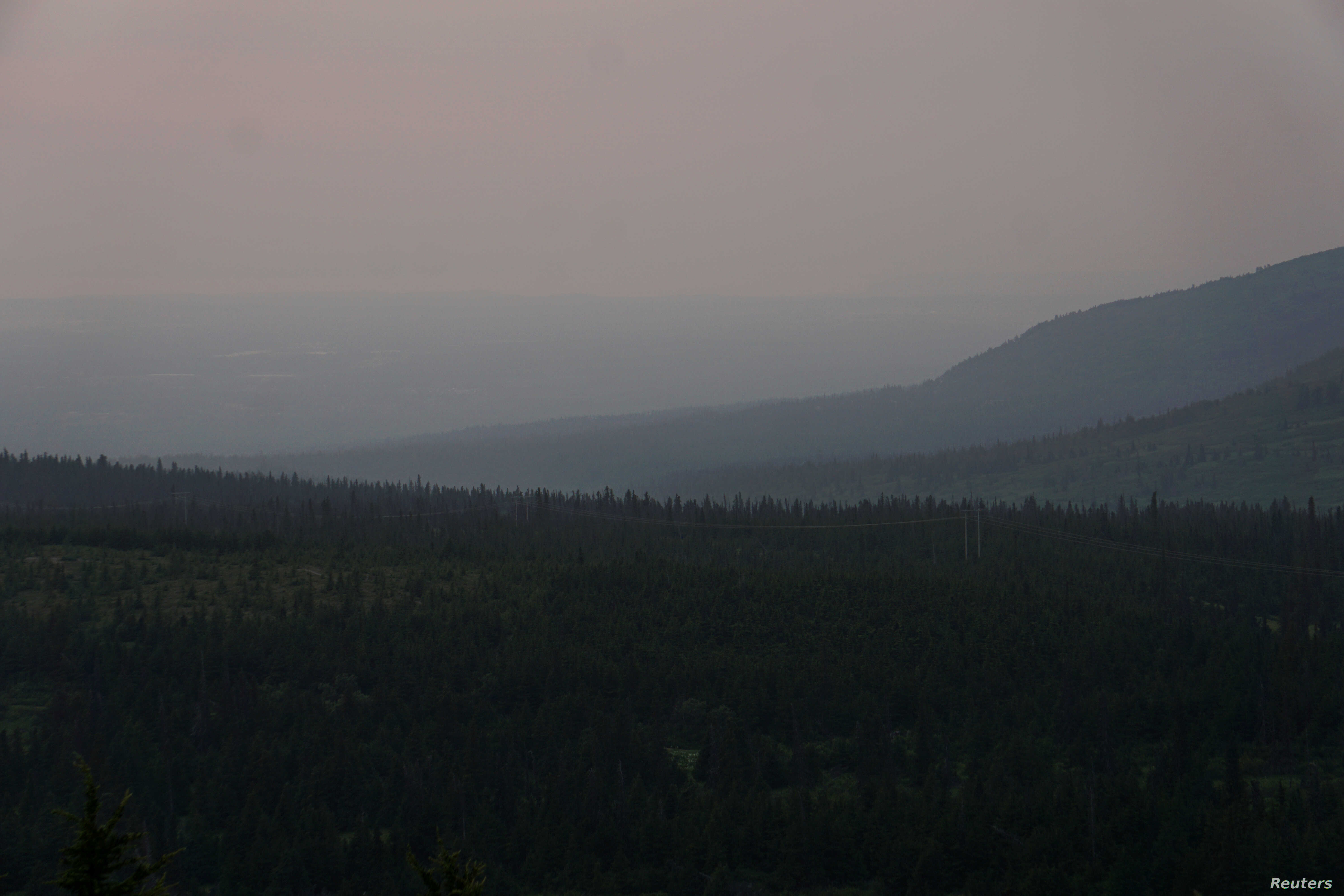 A general view of the skyline obscured by smoke taken from the Glen Alps trailhead of Chugach State Park in Anchorage, Alaska, June 29, 2019.