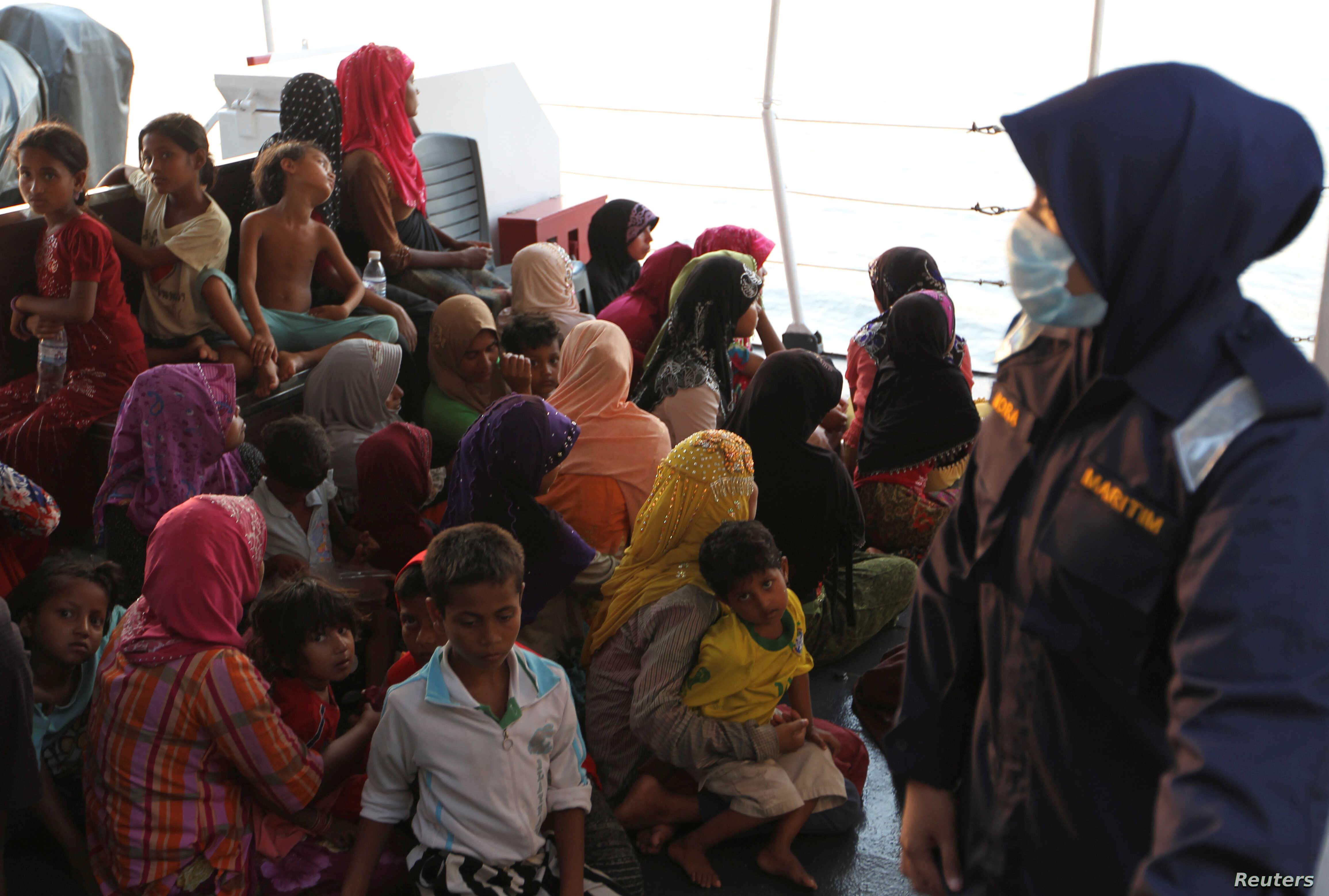 Rohingya refugees who were intercepted by Malaysian Maritime Enforcement Agency off Langkawi island, wait to be escorted to immigration authorities, at the Kuala Kedah ferry jetty, April 3, 2018.