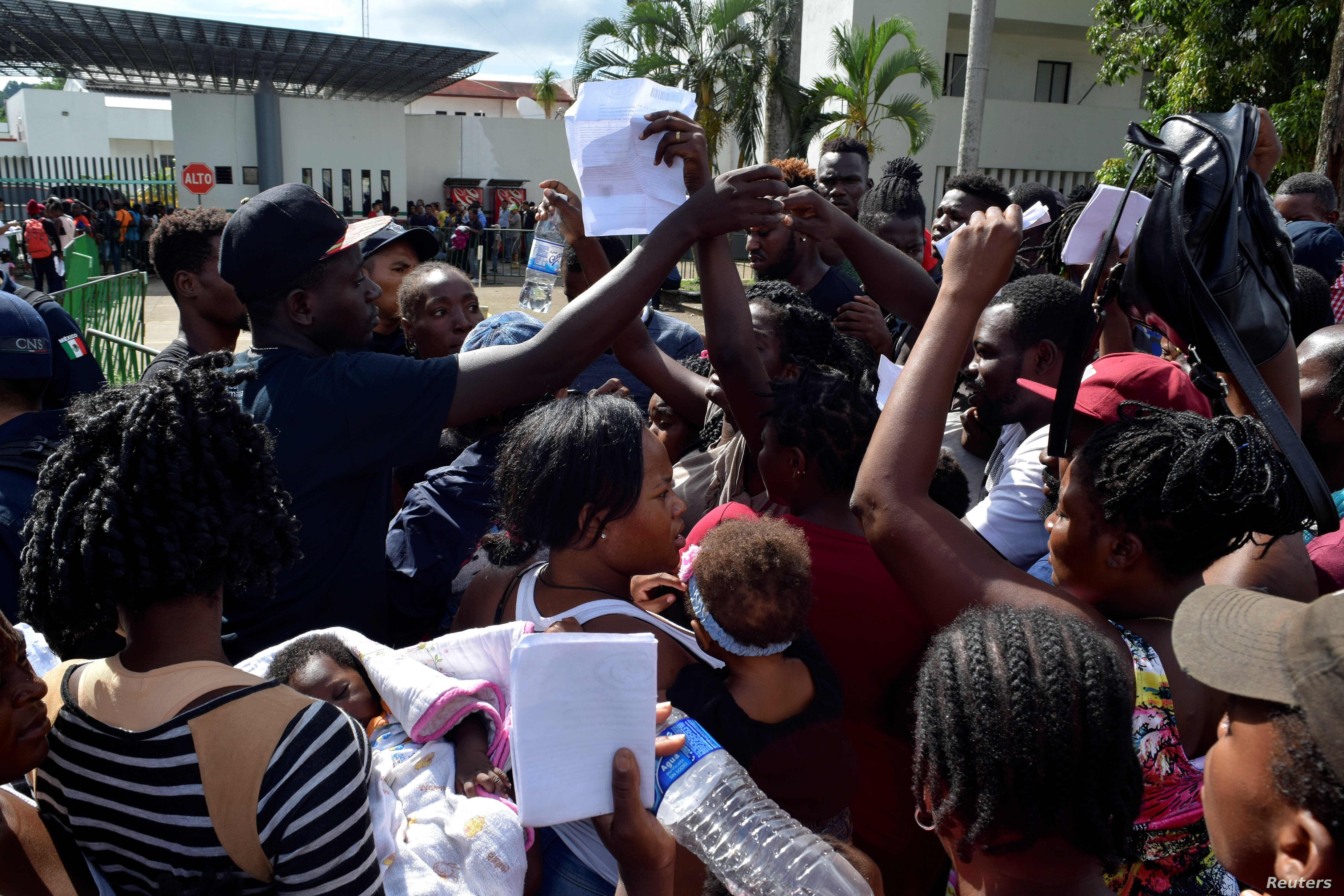 Migrants from Africa and Haiti try to enter the Siglo XXI immigrant detention center to request humanitarian visas, issued by the Mexican government, to cross the country toward the United States, in Tapachula, Mexico, June 27, 2019.
