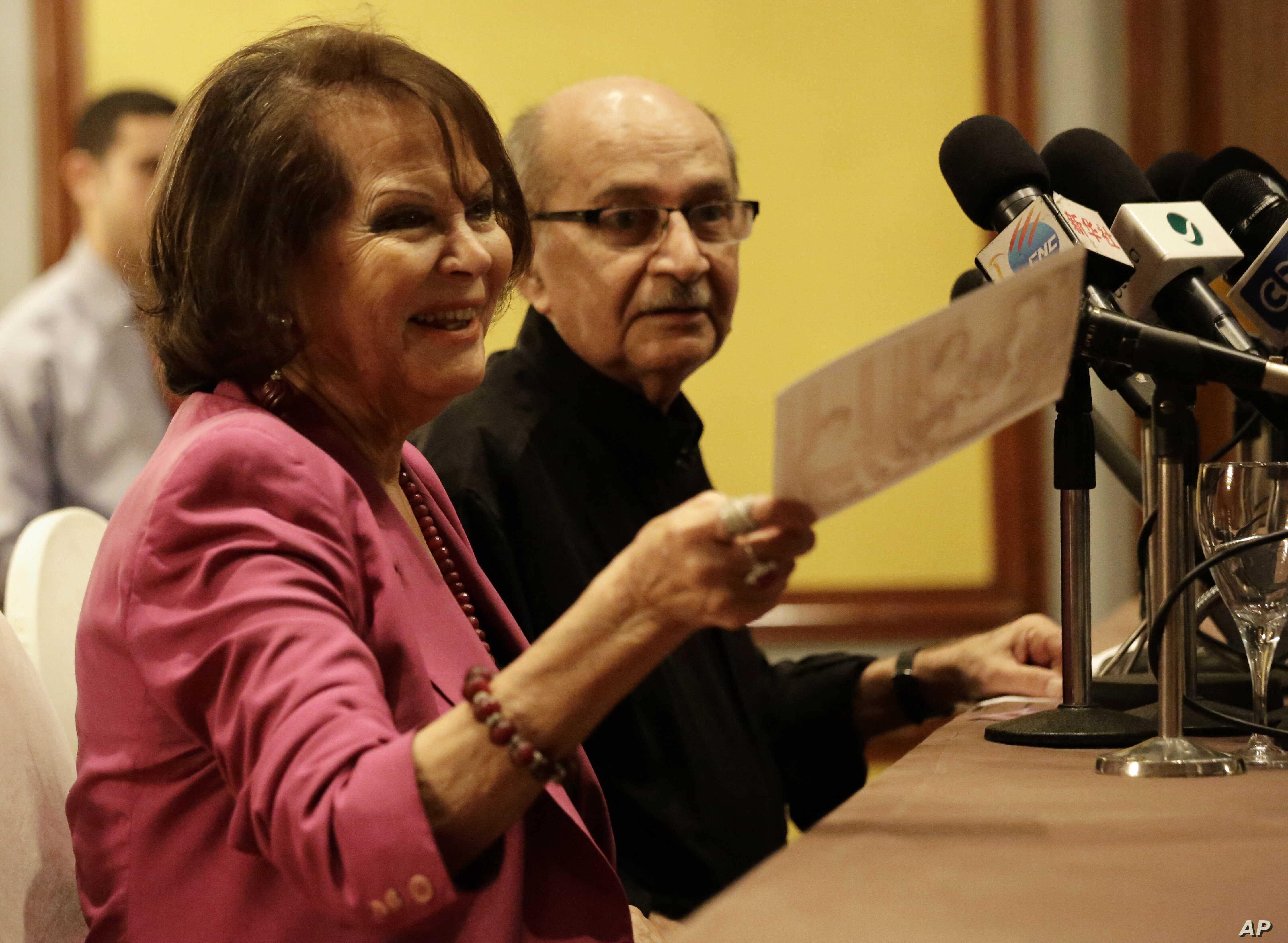 Italian actress Claudia Cardinale holds an old photo that was presented to her at a   press conference with Festival Artistic Director, Youssef Cherif Rizkallah on the first day of   the 37th Cairo International Film Festival, Cairo Egypt, Nov. 11, 2015.