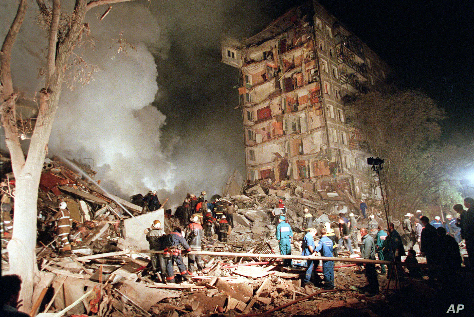 FILE - Rescuers and firefighters work at the site of a massive explosion that destroyed a nine-story apartment building in the southeastern part of Moscow in September 1999.