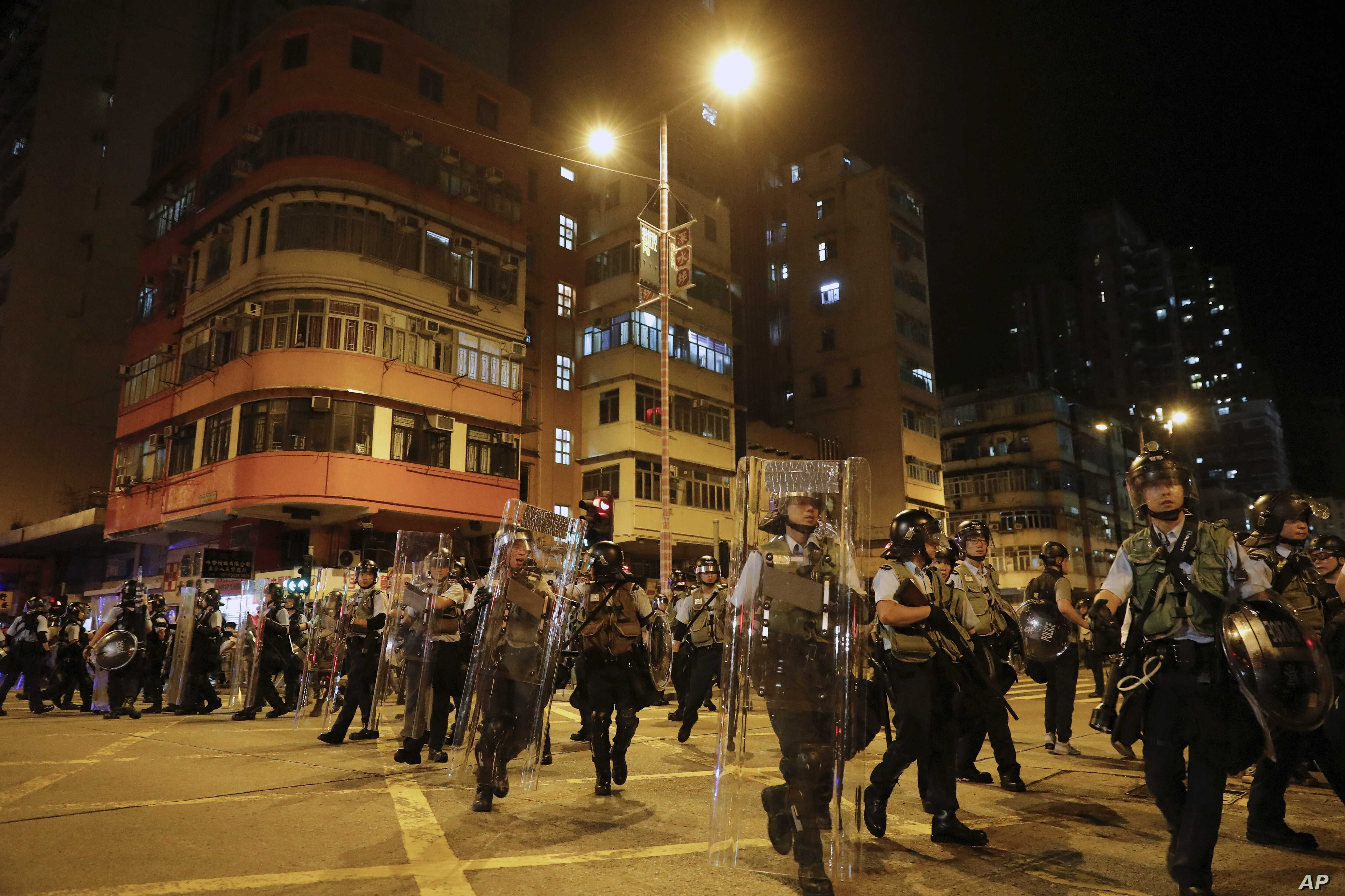 Riot policemen arrive to disperse the residents and protesters at Sham Shui Po district in Hong Kong, Aug. 7, 2019.