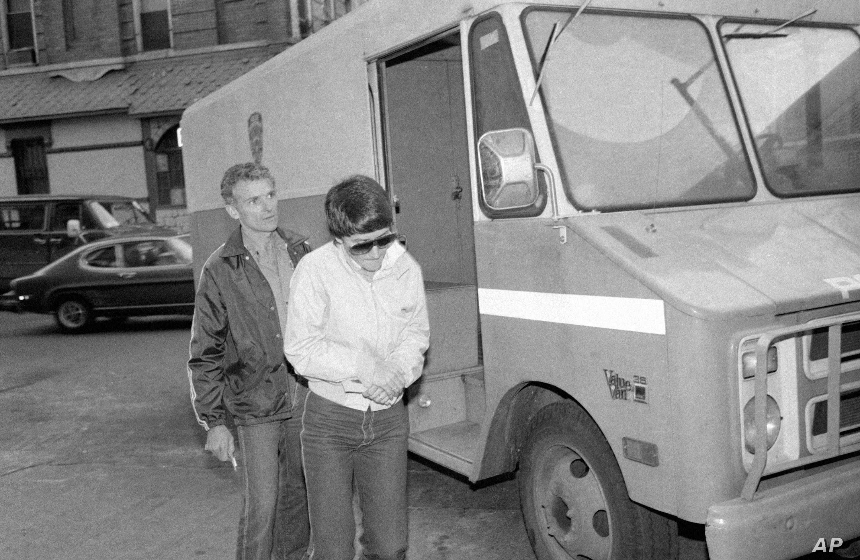 FILE - Rosie Ruiz, who was accused of cutting corners to win the Boston Marathon two years ago, leaves Central Booking at Police Headquarters in New York, April 20, 1982, where she was charged with stealing $60,000 from the firm where she worked.