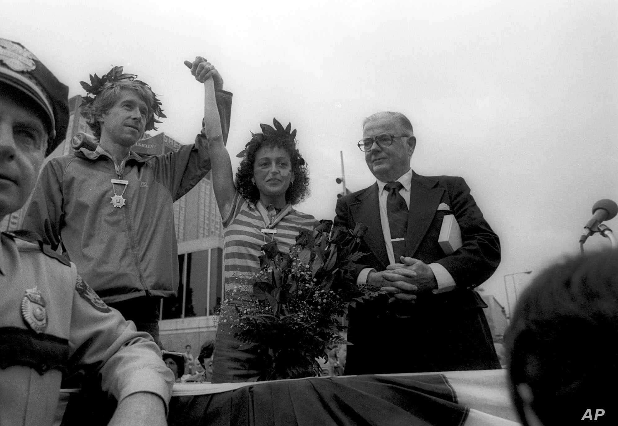 FILE - Jacqueline Gareau of Montreal has her hand held high by runner Bill Rodgers on May 14, 1980, in Boston, three weeks and two days after the Boston Marathon. Gareau had apparently finished second on the day of the race, but Rosie Ruiz, the first woman across the finish line, was disqualified.