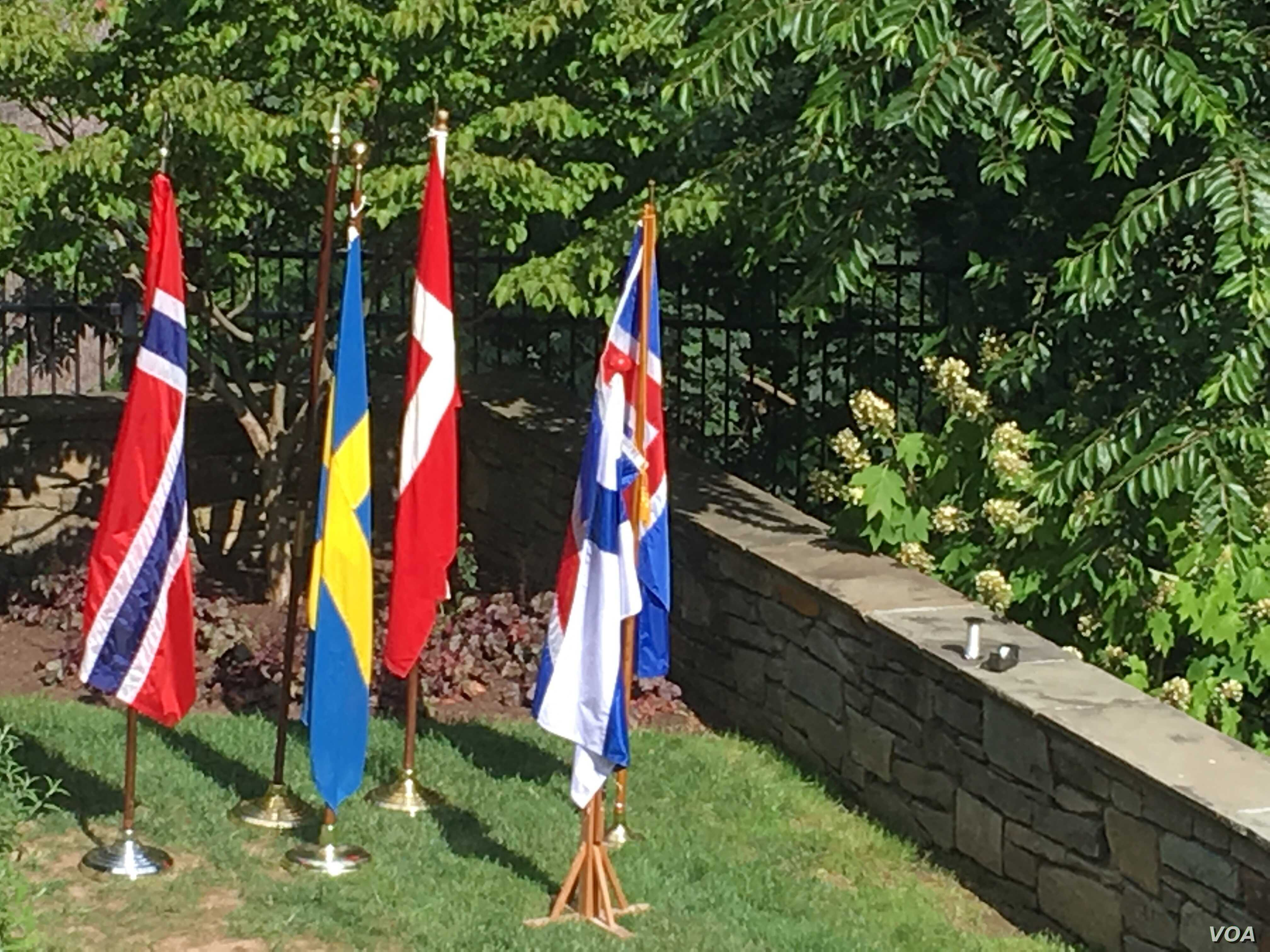 The flags of Nordic countries are on display at a concert at the Danish Embassy celebrating the 2019 Nordic Jazz Festival. (VOA/N. Liu)