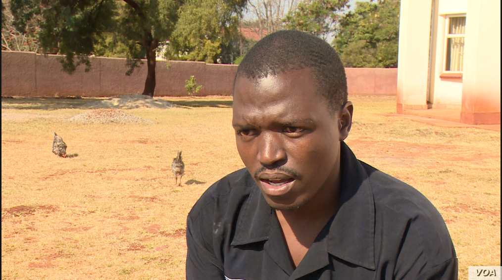 Loveday Munesi, pictured in Harare, Aug. 1, 2019, has been unable to work or walk comfortably since in bullet lodged in his right buttock last year when the army attacked protesters. (Columbus Mavhunga/VOA)