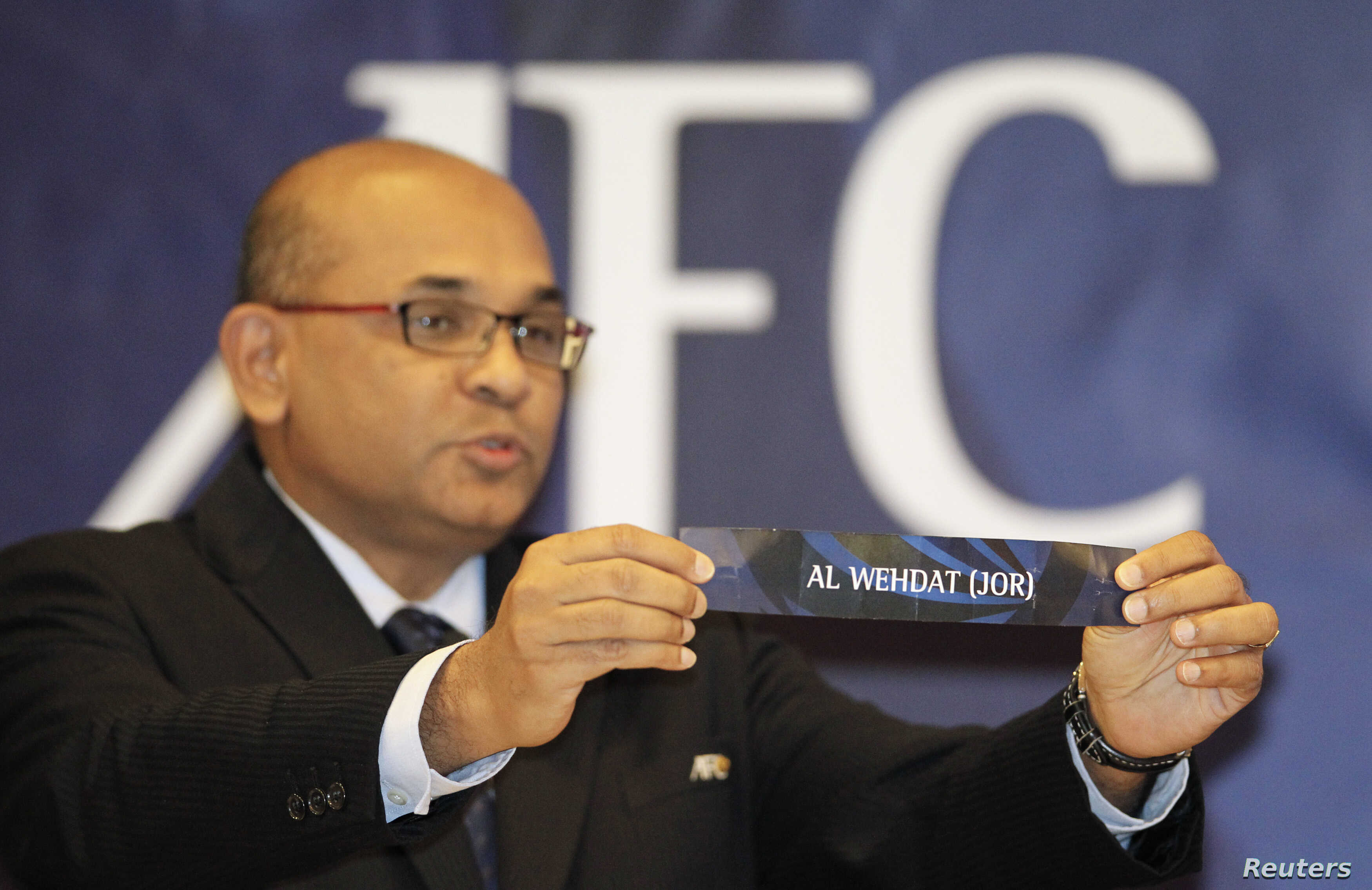 FILE - Asian Football Confederation (AFC) Executive Director Windsor John displays a slip during the draw for the AFC Cup Knockout Stage at the AFC House in Kuala Lumpur, June 14, 2012.