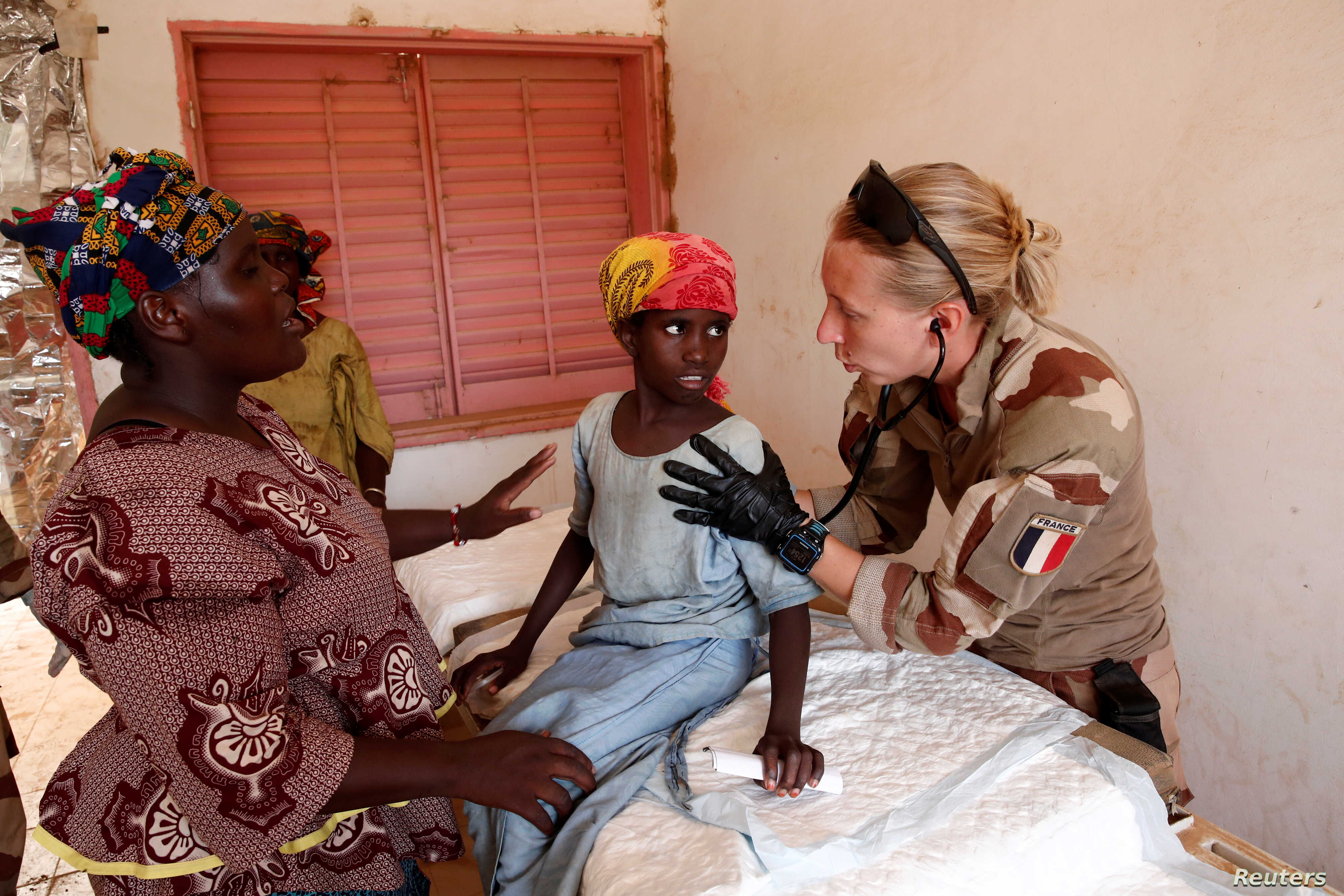 A member of a French military medical unit provides medical action for the benefit of the population during Operation Barkhane in Ndaki, Mali, July 29, 2019.