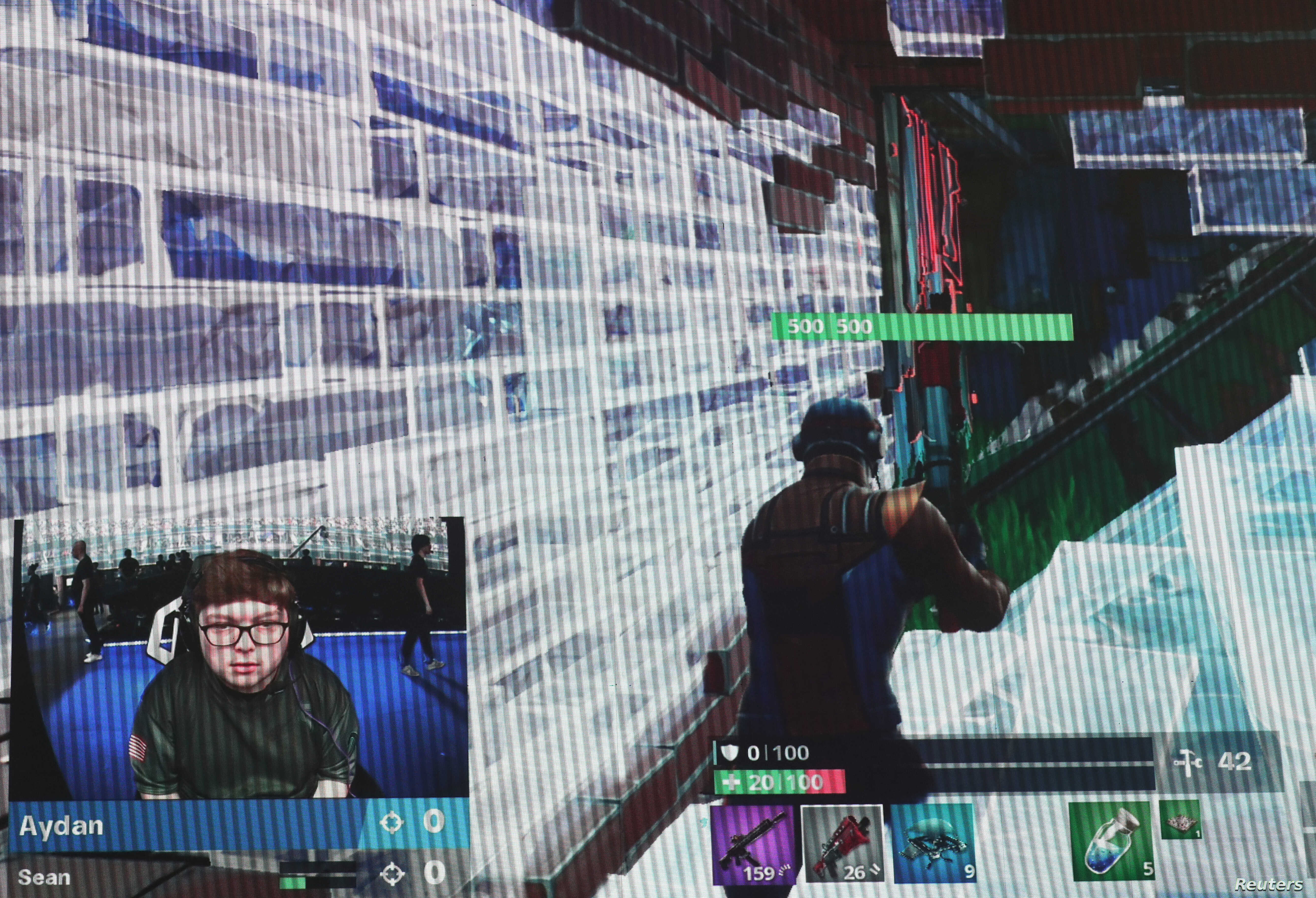 FILE - A contestant competes during the Fortnite World Cup Duos Finals in the Queens borough of New York, July 27, 2019.