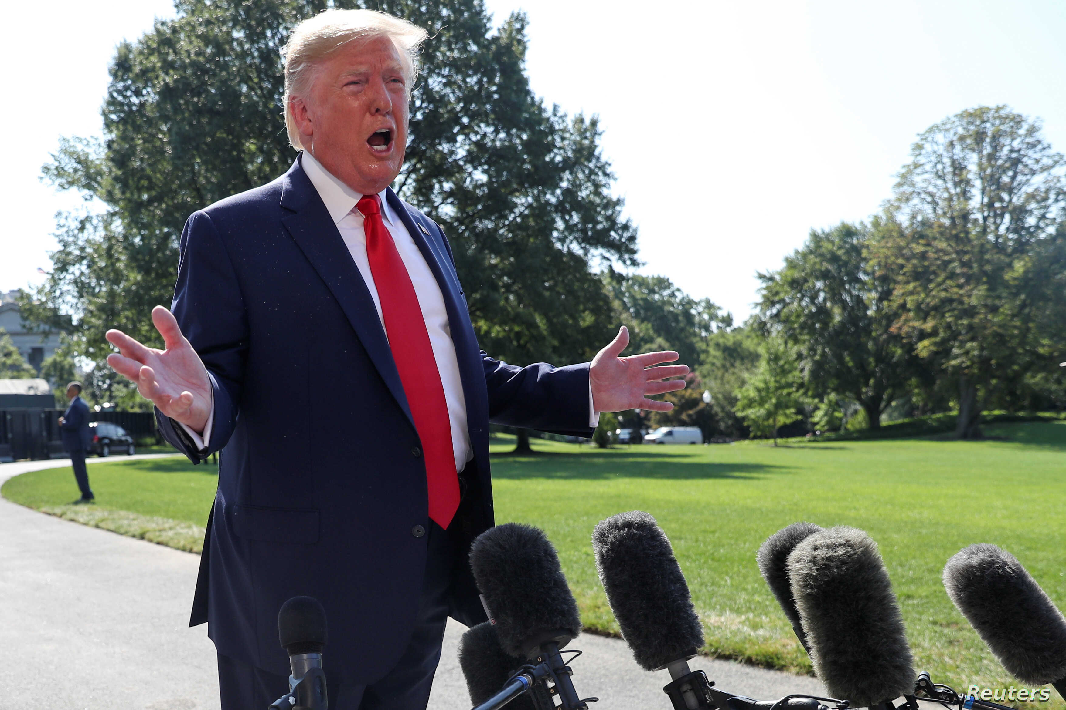 U.S. President Donald Trump talks to reporters as he departs for travel to New York and New Jersey from the South Lawn of the White House in Washington, Aug. 9, 2019.