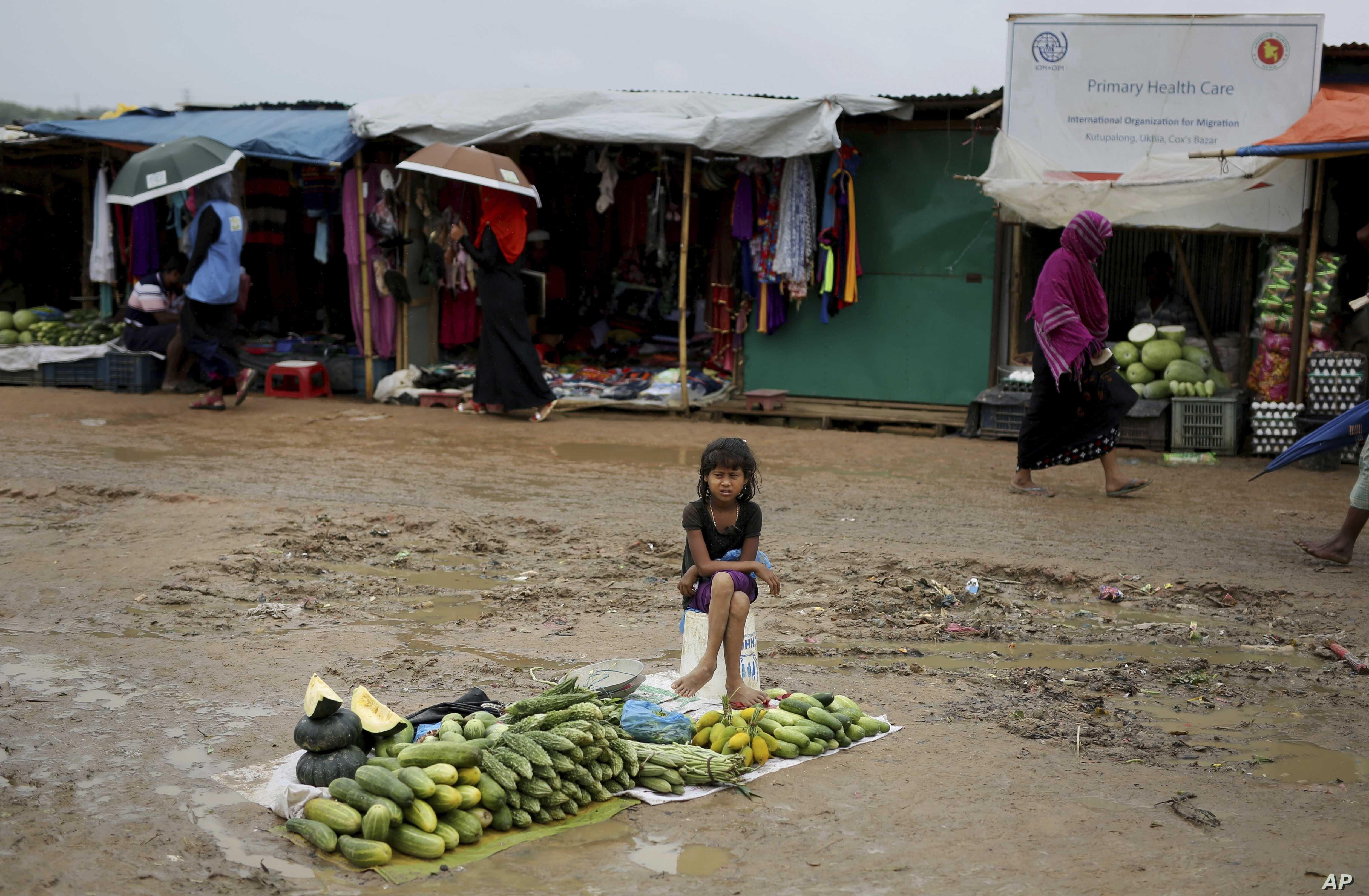 A Rohingya refugee girl sells vegetables in Kutupalong refugee camp Bangladesh Aug. 28 2018