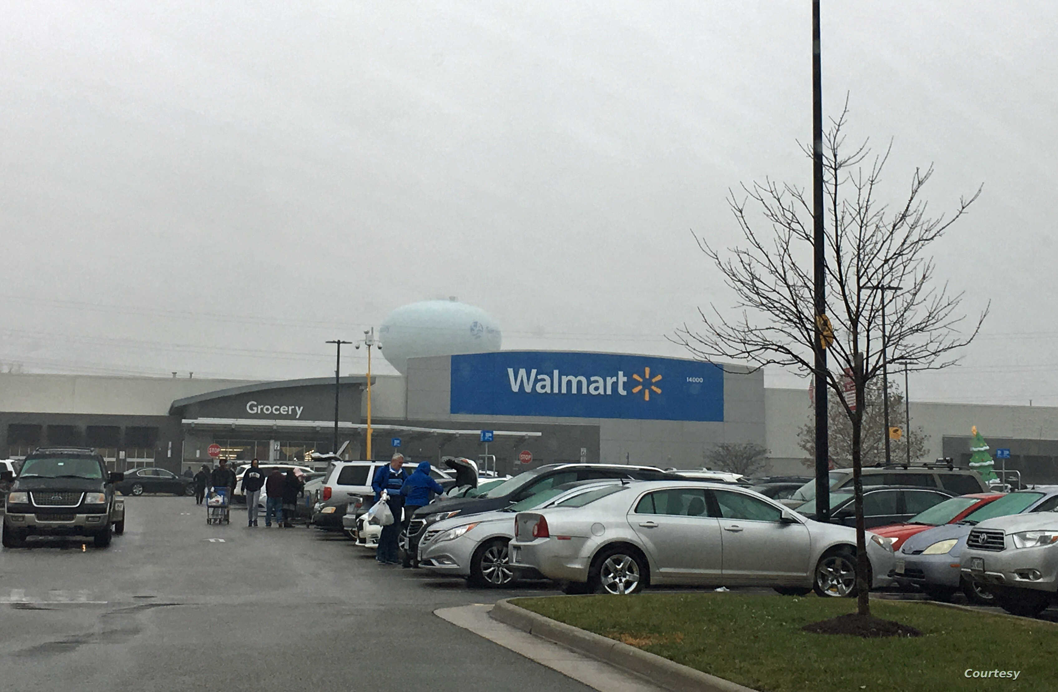 Shoppers walk in the parking lot of a Walmart store in Fairfax Virginia. Walmart says it will stop selling ammunition for handguns and assault-style weapons