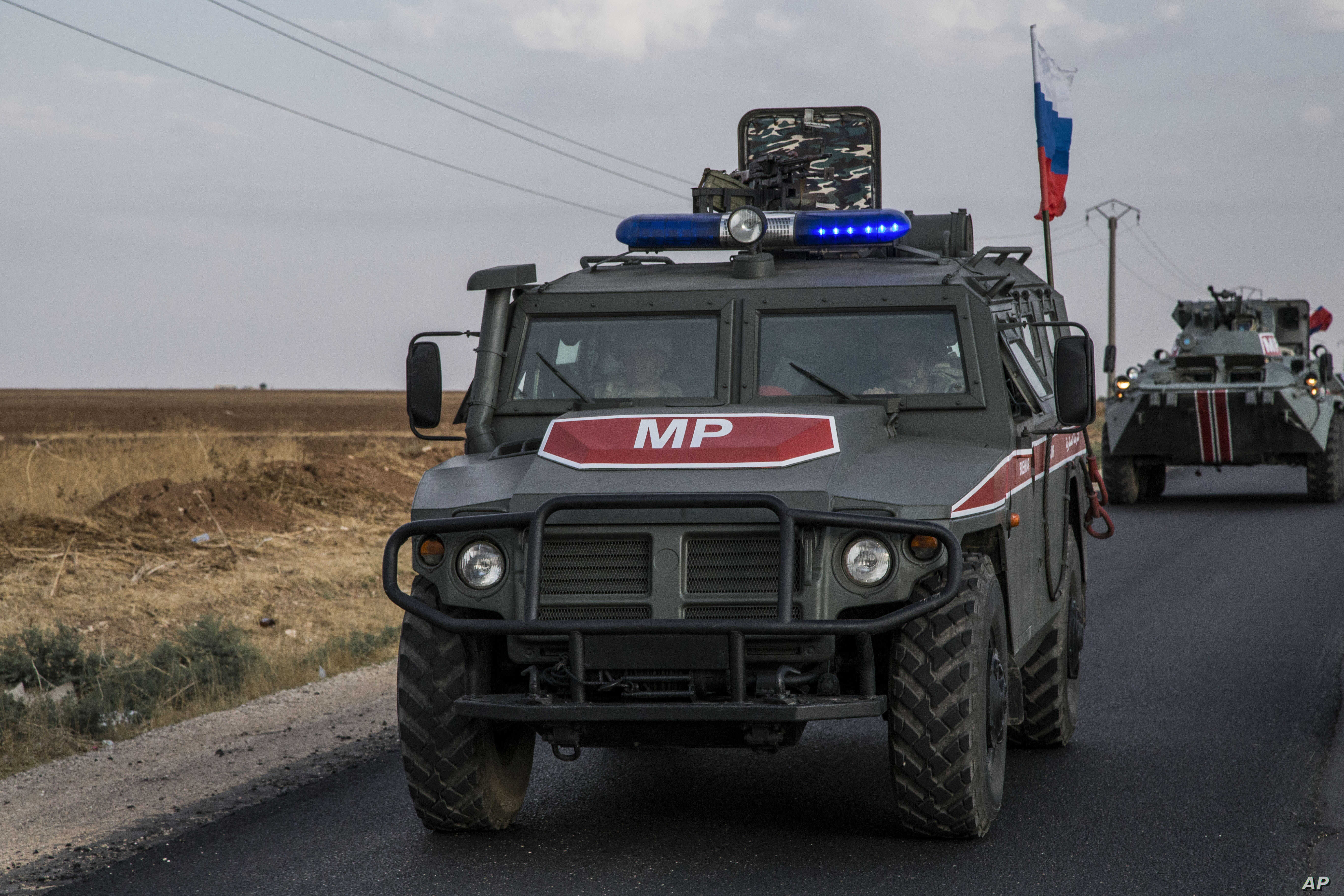 Russian forces patrol near the city of Qamishli north Syria. Russia's Defense