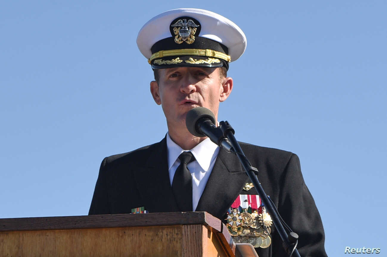 Fired US Navy captain leaves his ship to sailors applause
