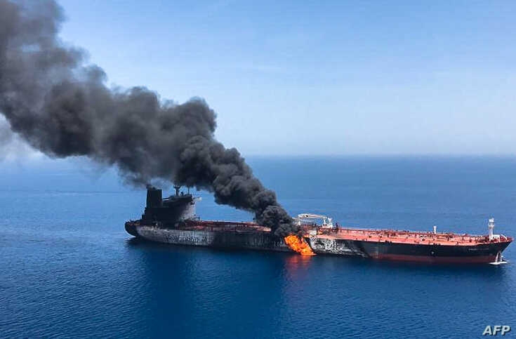TOPSHOT - A picture obtained by AFP from Iranian News Agency ISNA on June 13, 2019 reportedly shows fire and smoke billowing from Norwegian owned Front Altair tanker said to have been attacked in the waters of the Gulf of Oman. Suspected attacks…