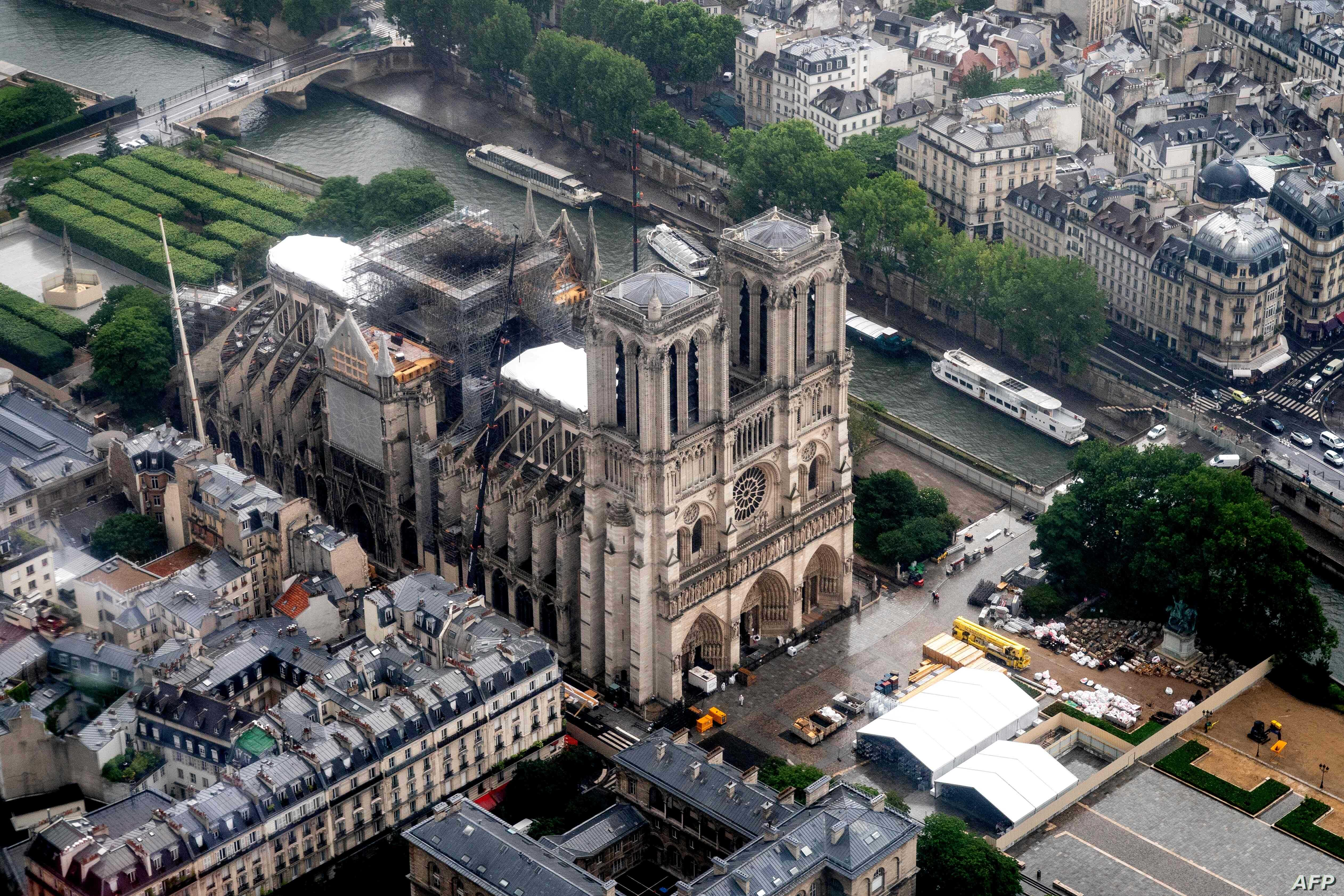 This aerial picture taken on June 12, 2019 in the French capital Paris shows the Notre Dame de Paris cathedral under repair after it was badly damaged by a huge fire on April 15.  / AFP / Lionel BONAVENTURE
