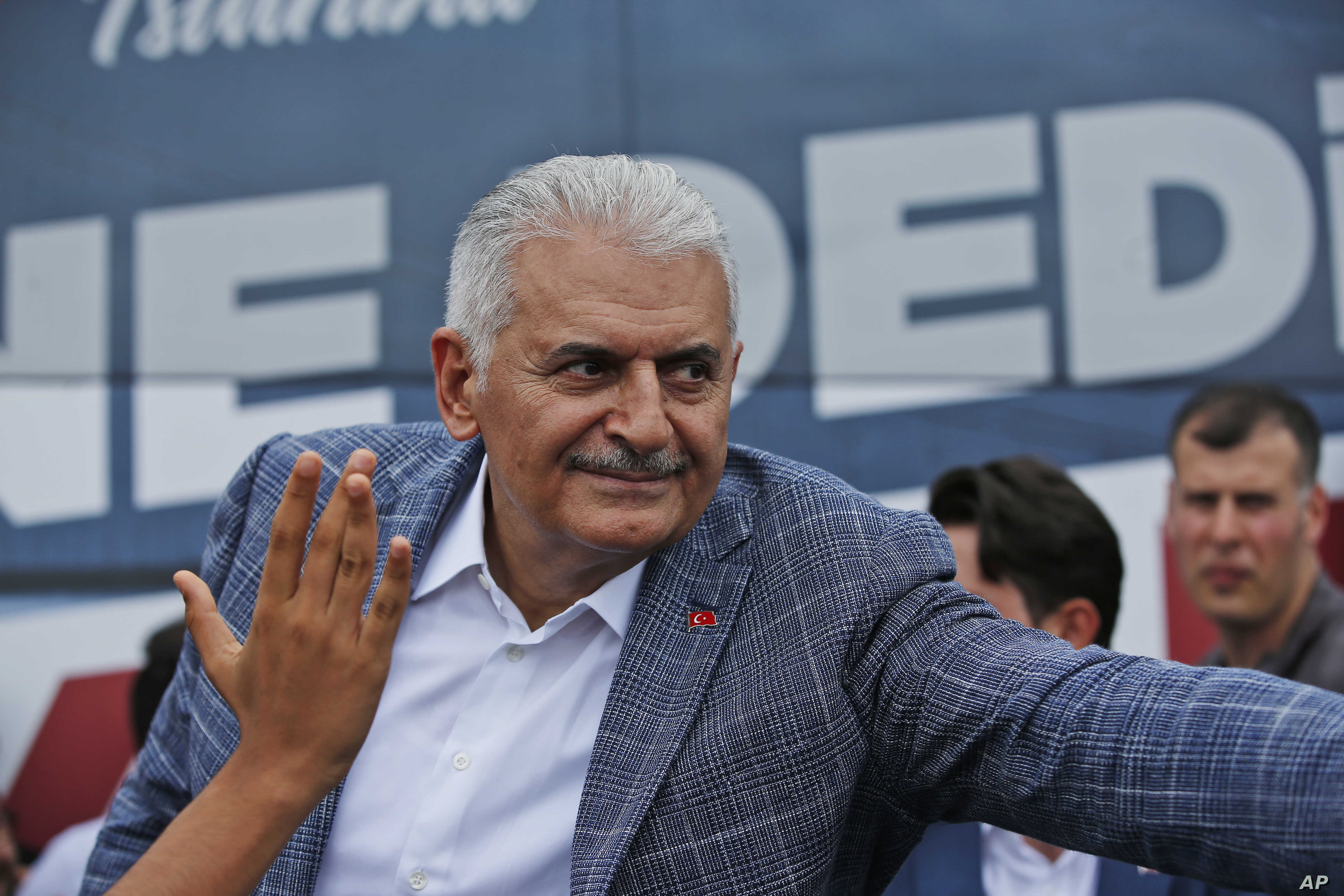 Binali Yildirim, mayoral candidate for Istanbul from Turkey's ruling Justice and Development Party, AKP, salutes supporters following a rally in Istanbul, Friday, June 21, 2019, ahead of June 23 re-run of mayoral elections. (AP Photo/Lefteris…