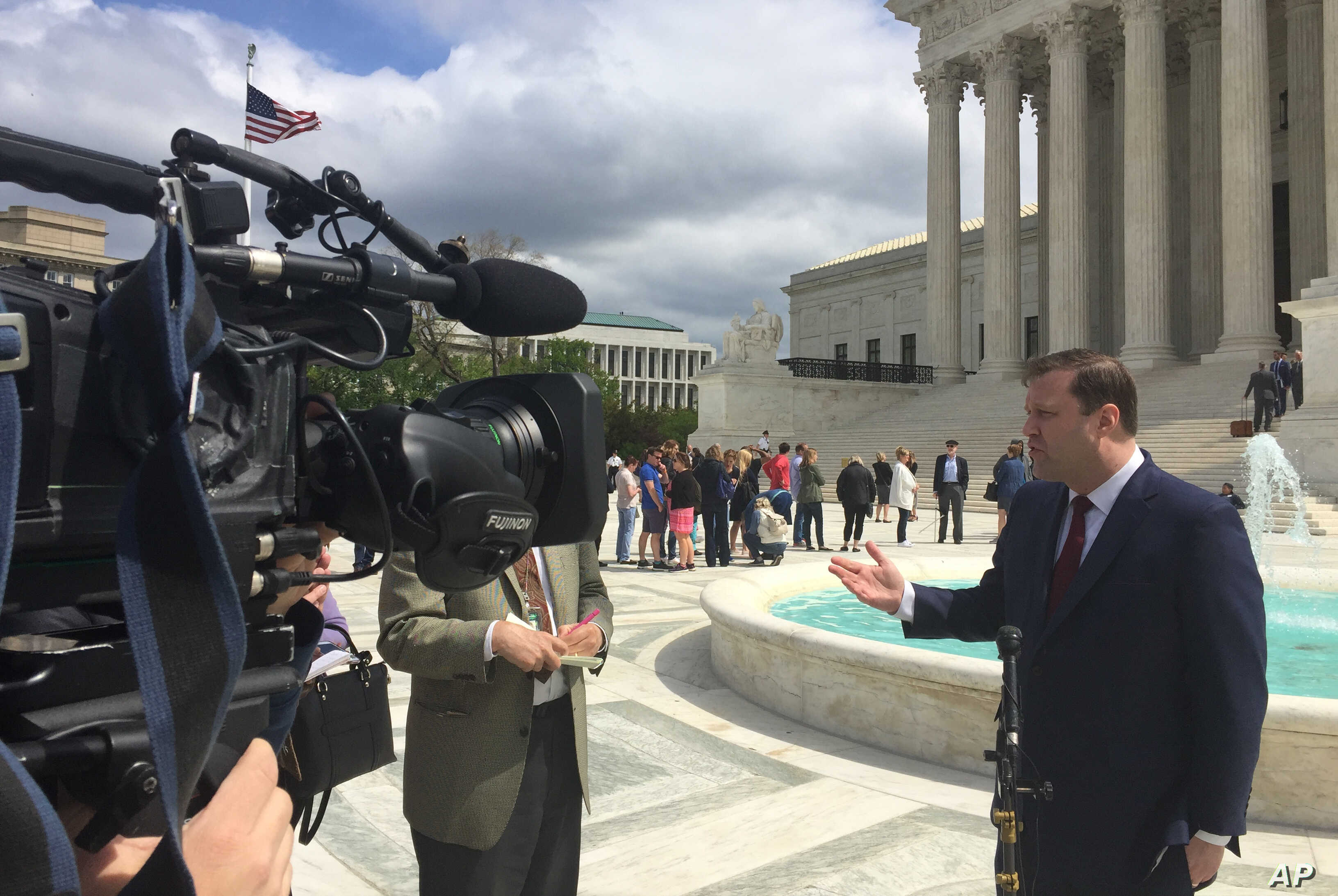 Food Marketing Institute lawyer Evan Young speaks to reporters outside the Supreme Court after the high court heard arguments in the supermarket trade association's case Monday, April 22, 2019, in Washington. FMI is arguing that the government…