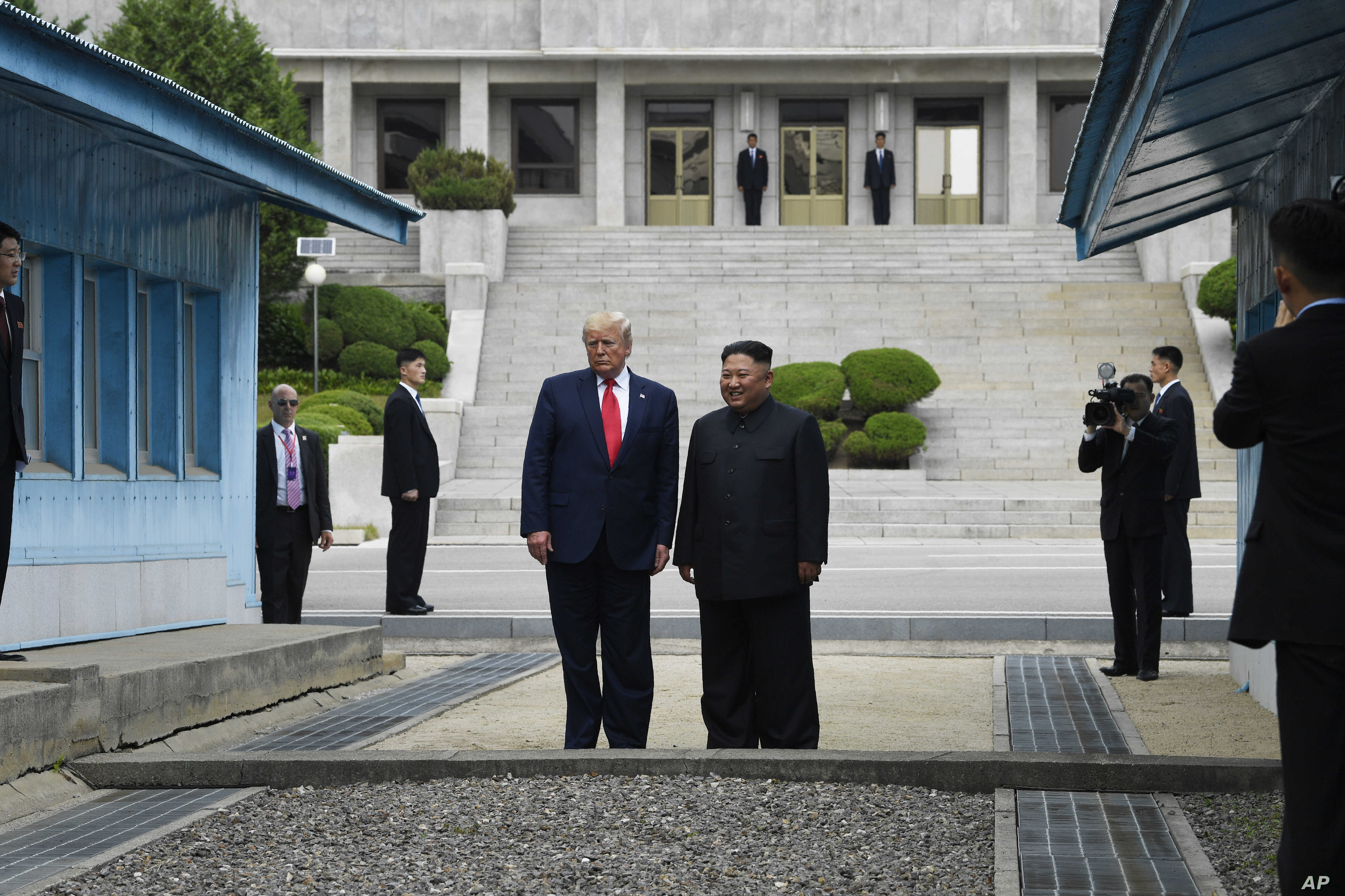 President Donald Trump and North Korean leader Kim Jong Un stand on the North Korean side in the Demilitarized Zone, Sunday, June 30, 2019 at Panmunjom. (AP Photo/Susan Walsh)
