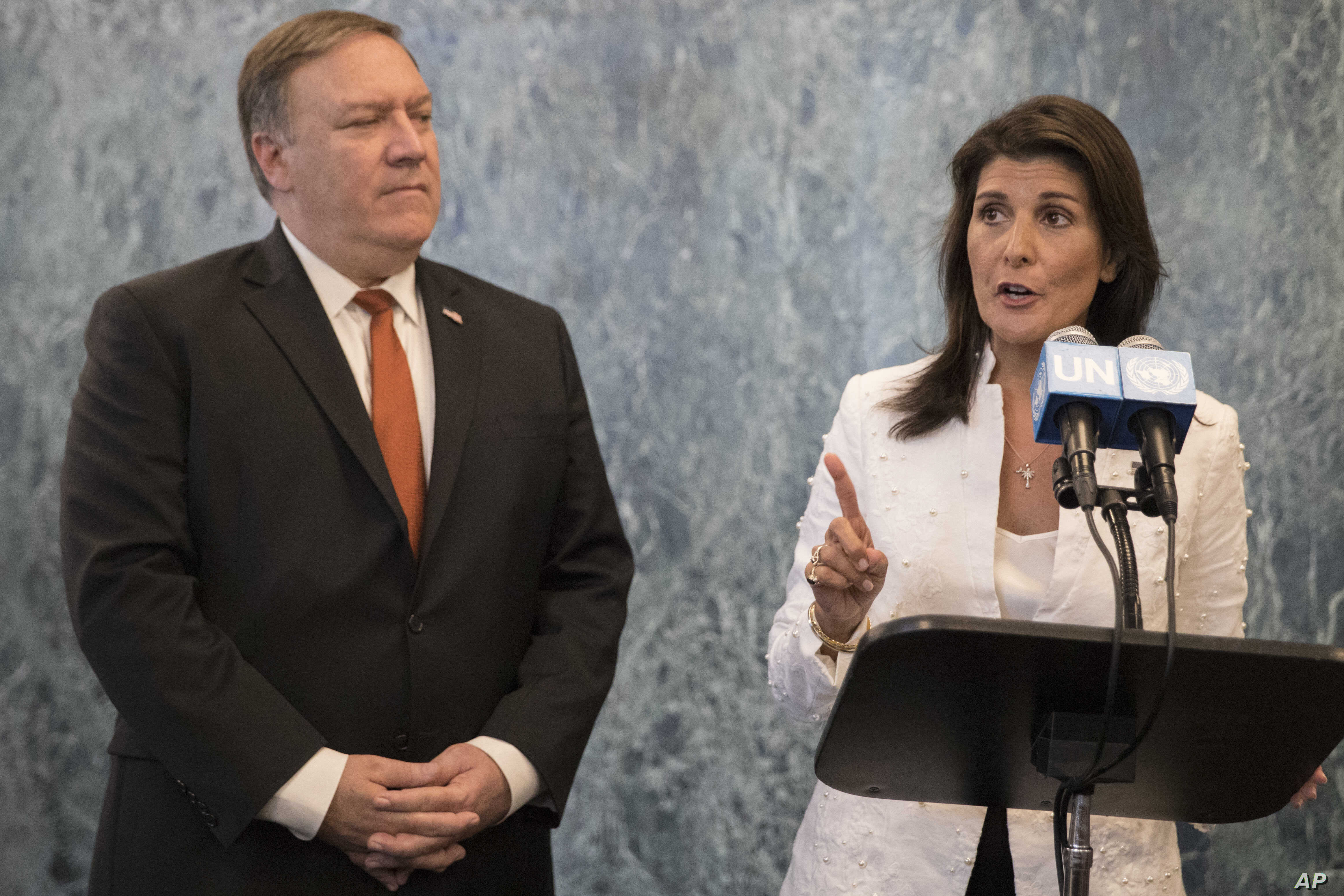 """FILE - In this Friday, July 20, 2018 file photo, U. S. Secretary of State Mike Pompeo, left, and American Ambassador to the United Nations Nikki Haley speak to reporters at United Nations headquarters. The United States has called an urgent meeting of the U.N. Security Council for Monday, Sept. 17, 2018 in response to what it says are efforts by some countries """"to undermine and obstruct"""" sanctions against North Korea. (AP Photo/Mary Altaffer, File)"""