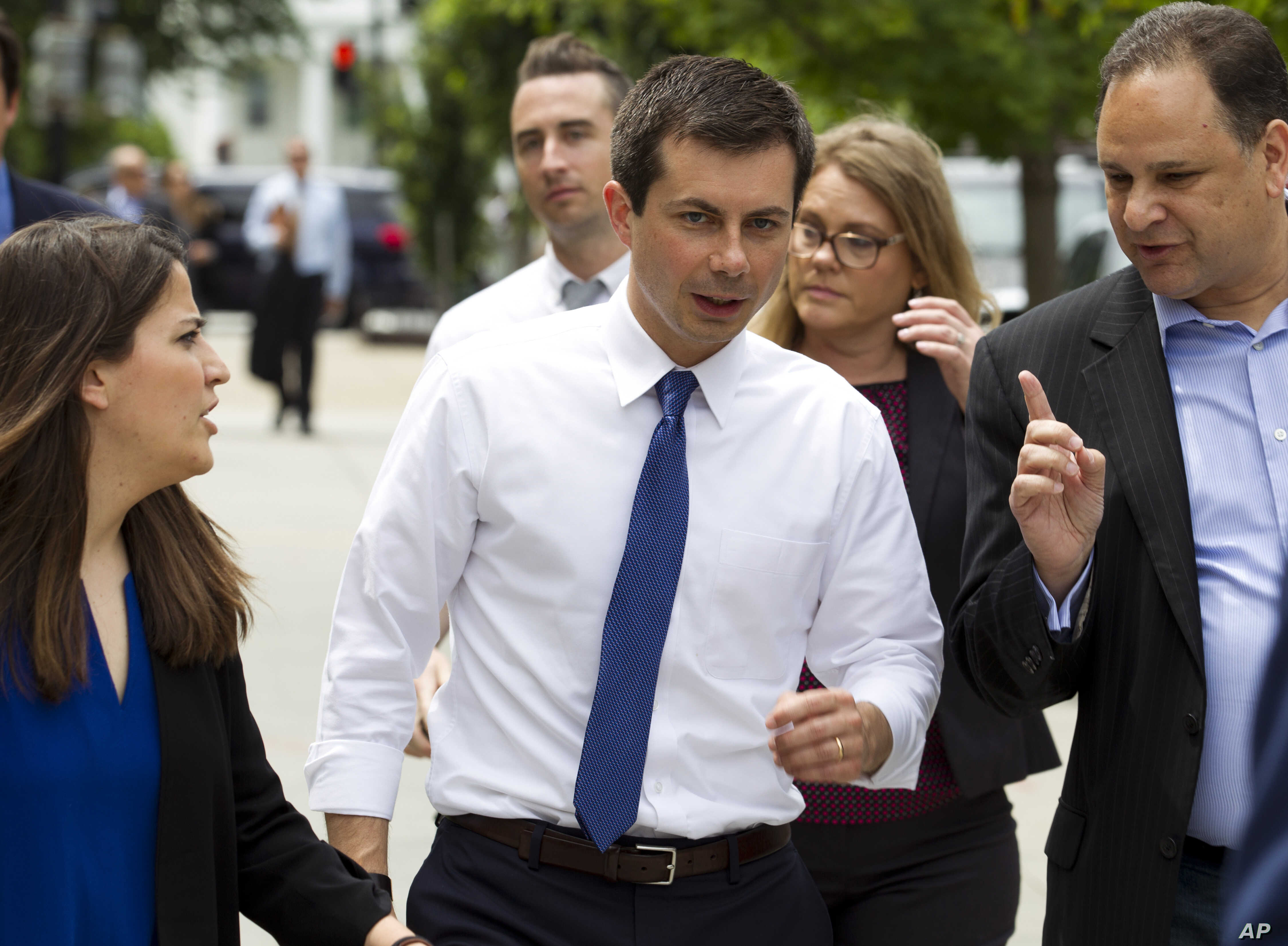 Democratic presidential candidate Mayor Pete Buttigieg, walks to his car after attending a rally, protesting against President Donald Trump policies outside of the White House in Washington, Wednesday, June 12, 2019. (AP Photo/Jose Luis Magana)