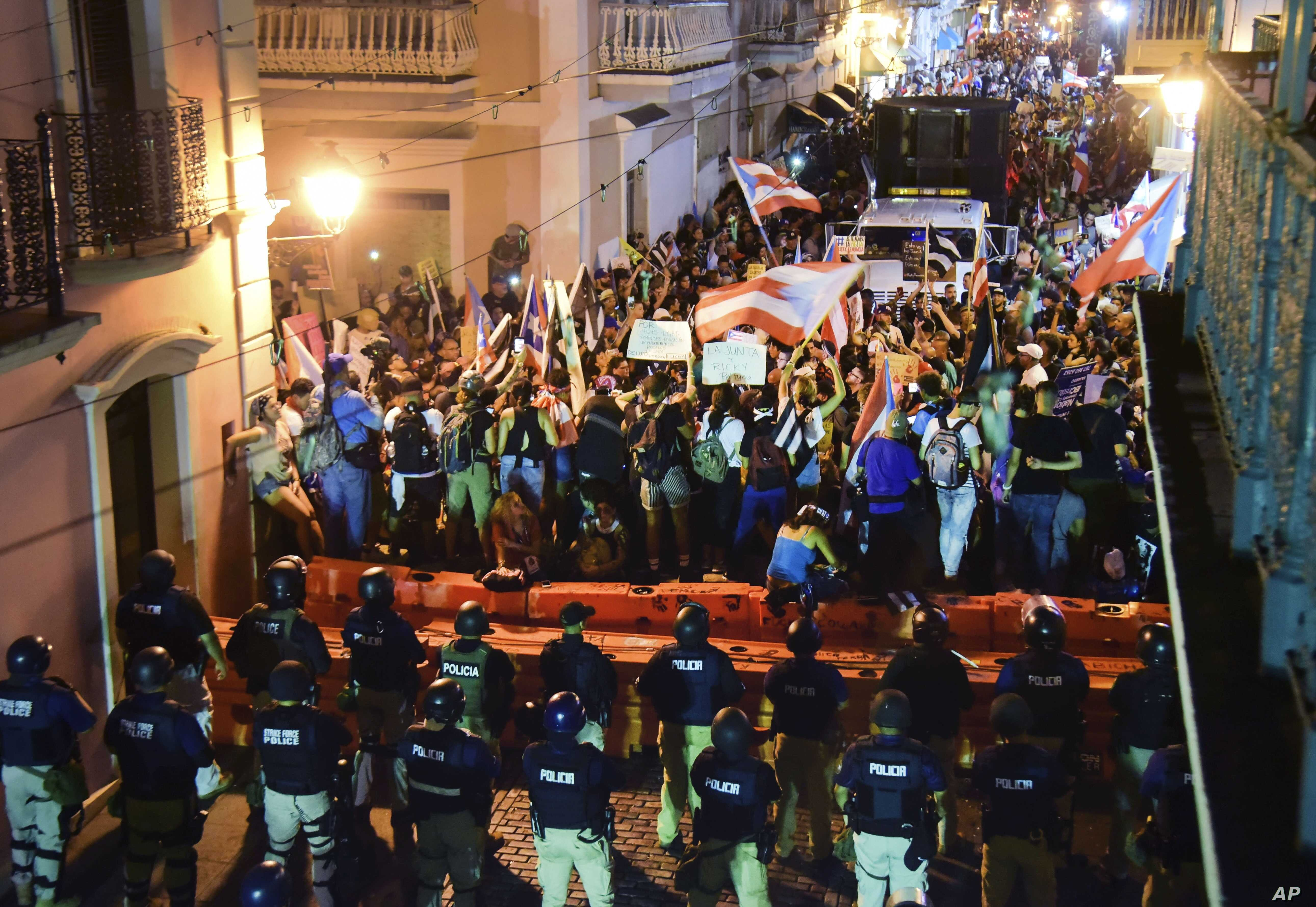 Demonstrators protest against governor Ricardo Rossello, in San Juan, Puerto Rico,  July 19, 2019. Protesters are demanding Rossello step down for his involvement in a private chat in which he used profanities.