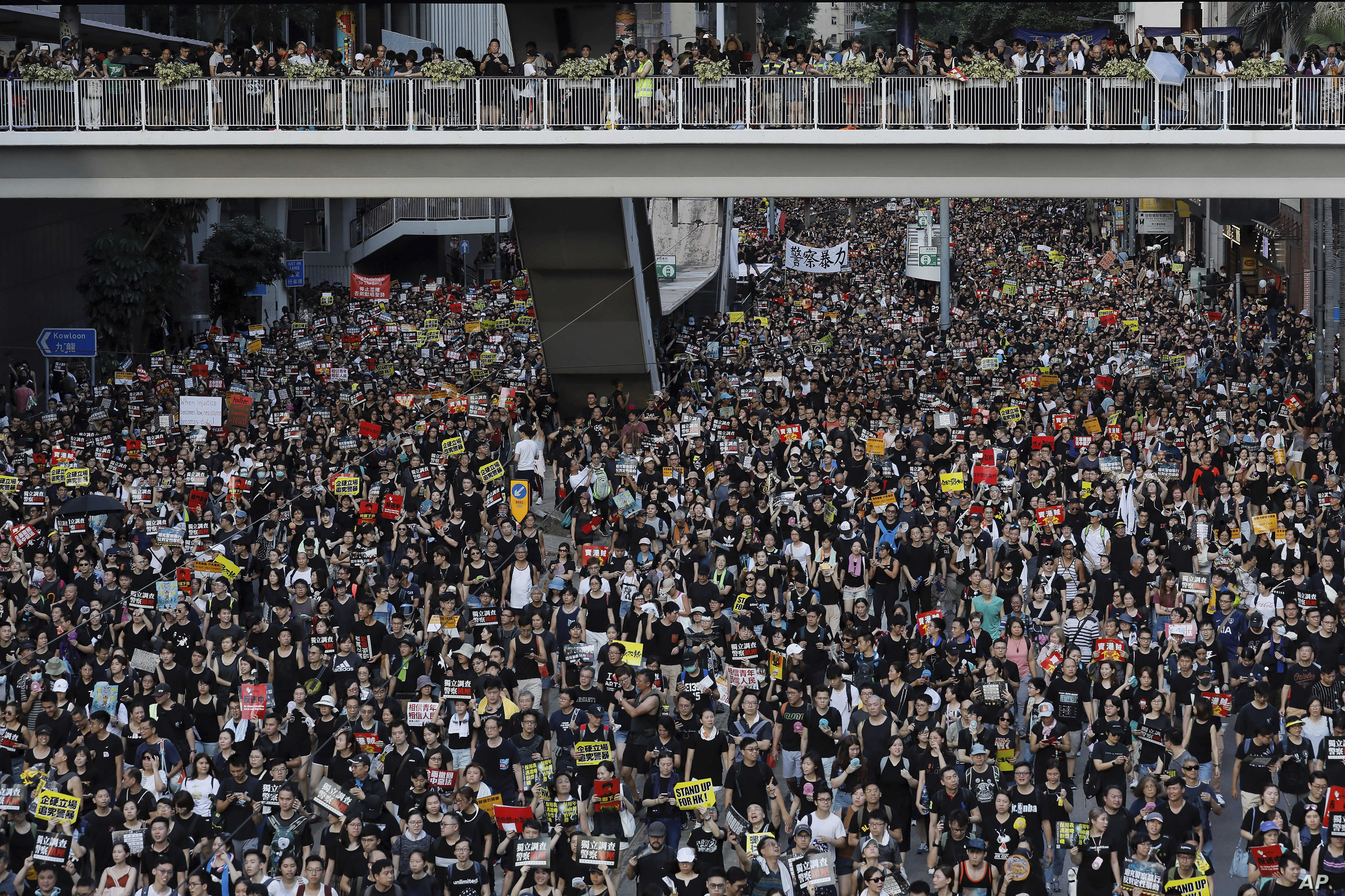 Protesters take part in a rally on Monday, July 1, 2019, in Hong Kong. Combative protesters tried to break into the Hong Kong legislature Monday as a crowd of thousands prepared to start a march in that direction on the 22nd anniversary of the…