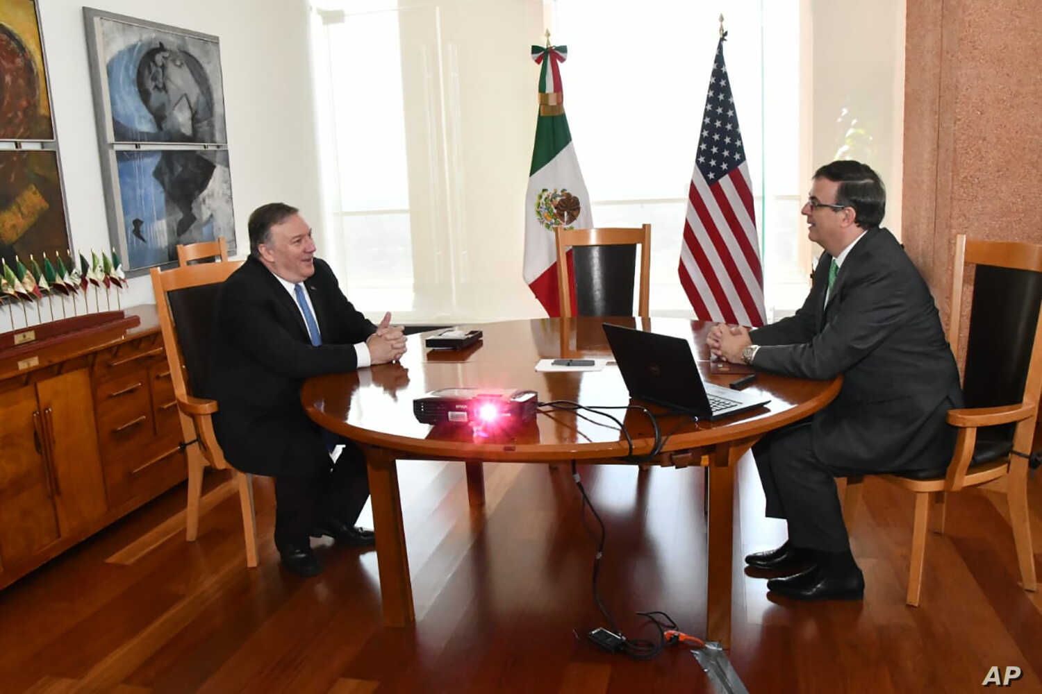 In this handout photo released by the Mexican Government Press Office, U.S. Secretary of State Mike Pompeo and his Mexican counterpart Marcelo Ebrard meet in Mexico City, Sunday morning, July 21, 2019. Pompeo's visit comes at the halfway point of a…