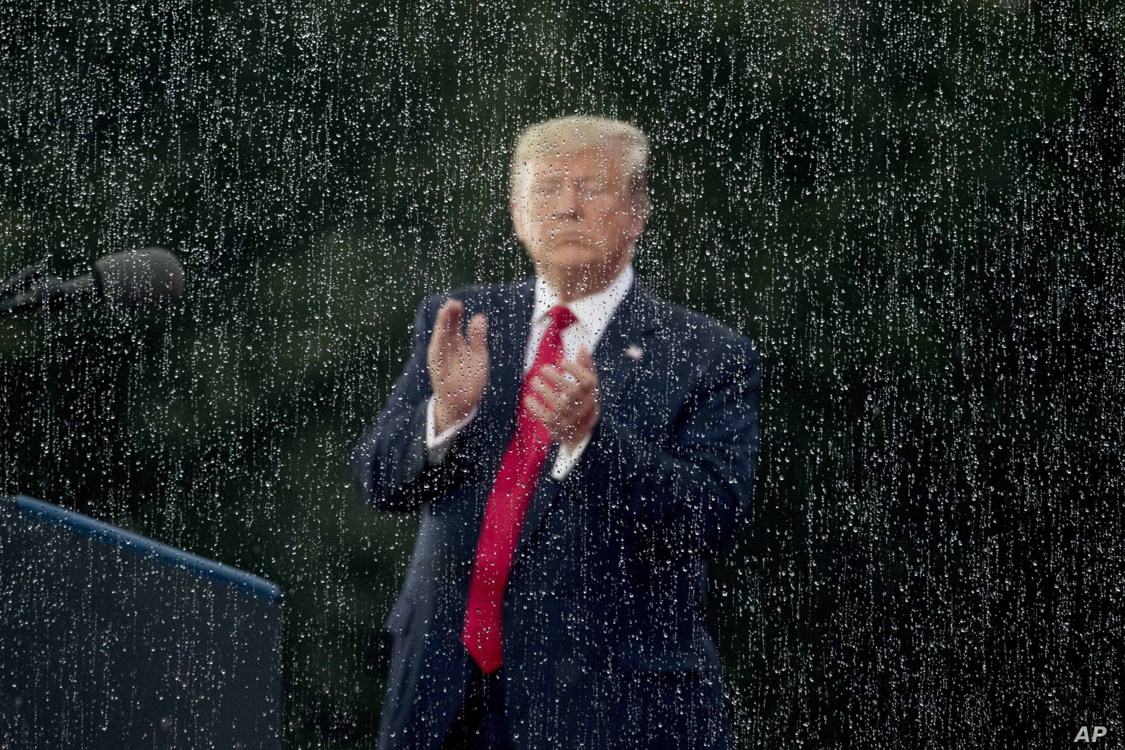 President Donald Trump applauds during an Independence Day celebration in front of the Lincoln Memorial, July 4, 2019, in Washington.