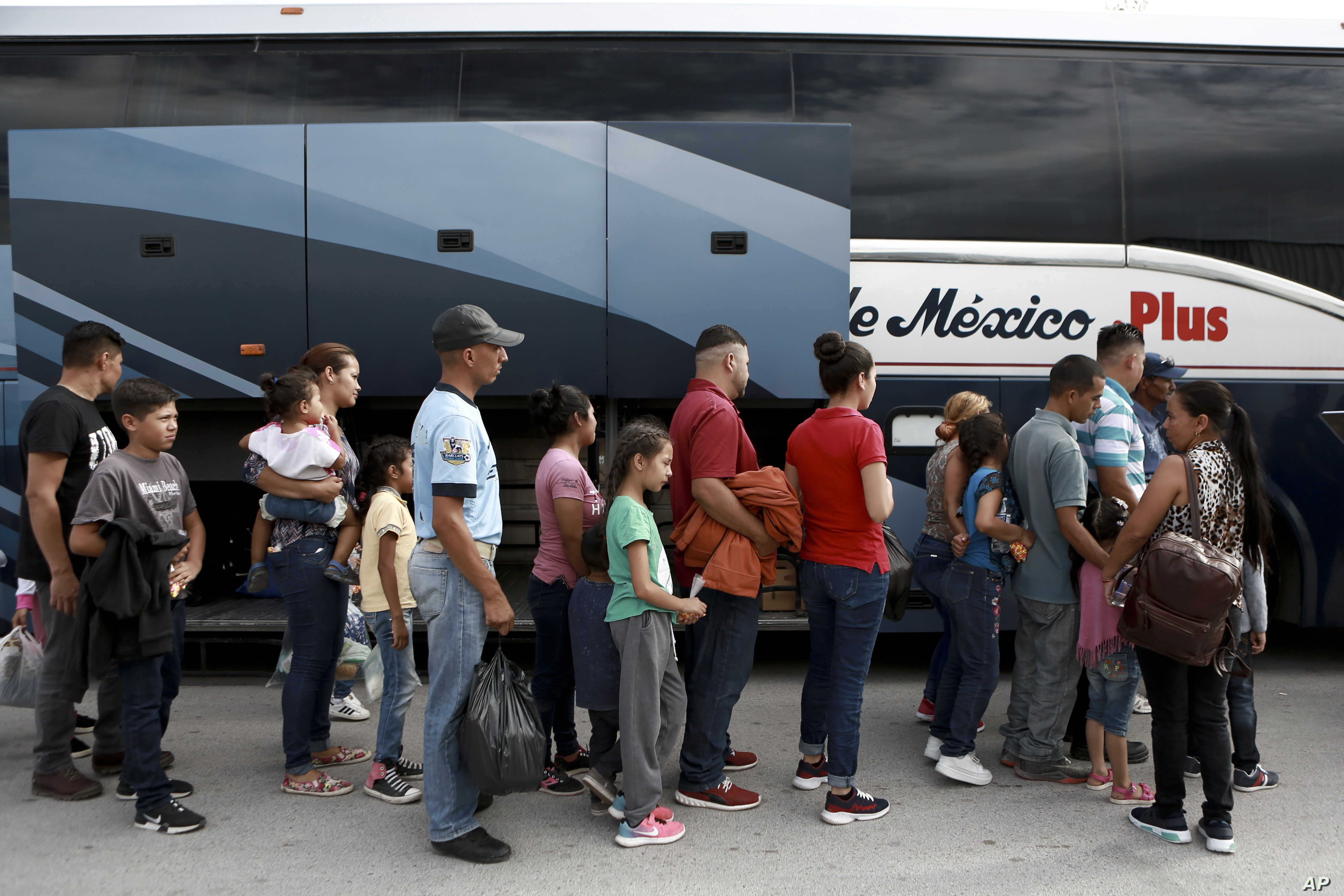 Central American migrants prepare to board a bus as they voluntarily return to their countries, in Ciudad Juarez, Mexico, Tuesday, July 2, 2019. Dozens of Central Americans who had been returned to the border city of Juarez to await the outcome of…