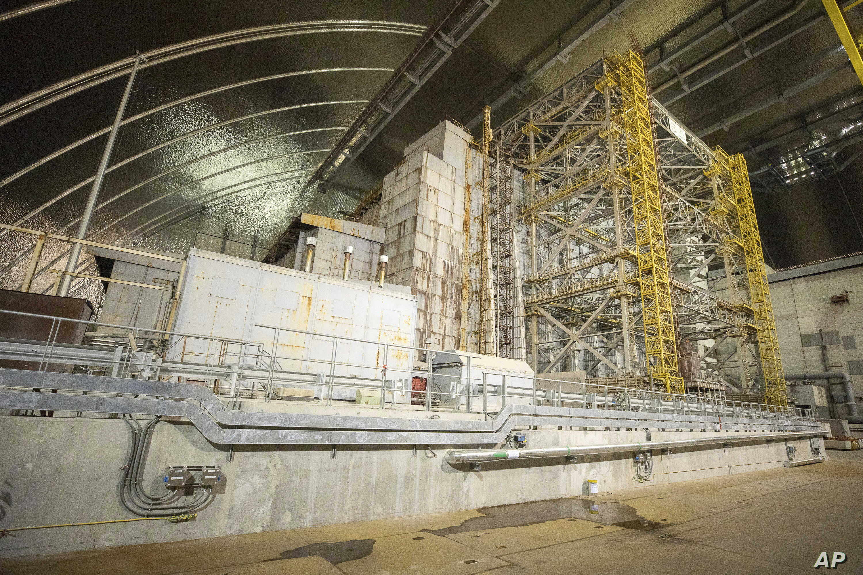 "A view inside the ""new safe confinement"" shelter that spans the remains of the Chernobyl nuclear power plant's Reactor No. 4, in Chernobyl, Ukraine, Wednesday, July 10, 2019. A structure built to confine radioactive dust from the nuclear reactor at…"