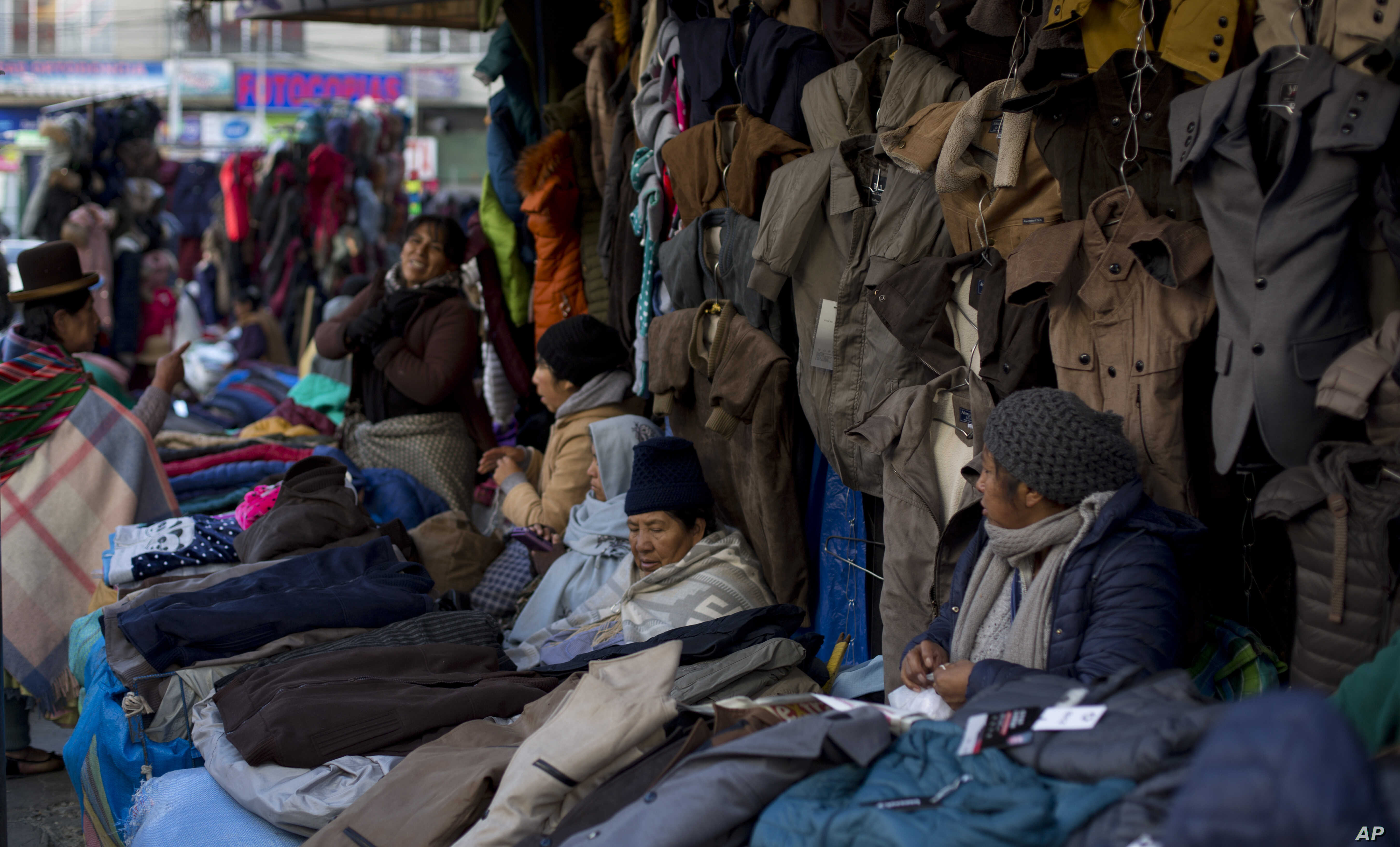 In this June 4, 2019 photo, women sell coats in downtown La Paz, Bolivia. The number of people who joined the informal sector has swelled to about 50%, one of the region's highest. Since President Evo Morales took office in 2006, the economy has…