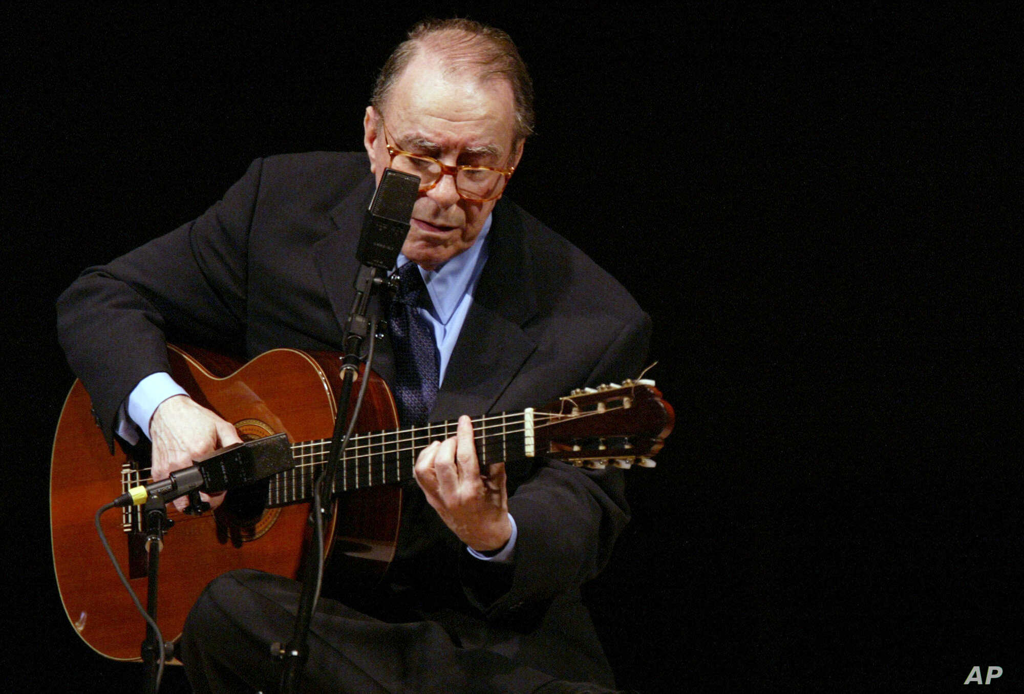 FILE - In this June 18, 2004 file photo, Brazilian composer Joao Gilberto performs at Carnegie Hall, in New York. The Brazilian singer and composer, who is considered one of the fathers of the Bossa Nova genre, has died. His death was confirmed by…